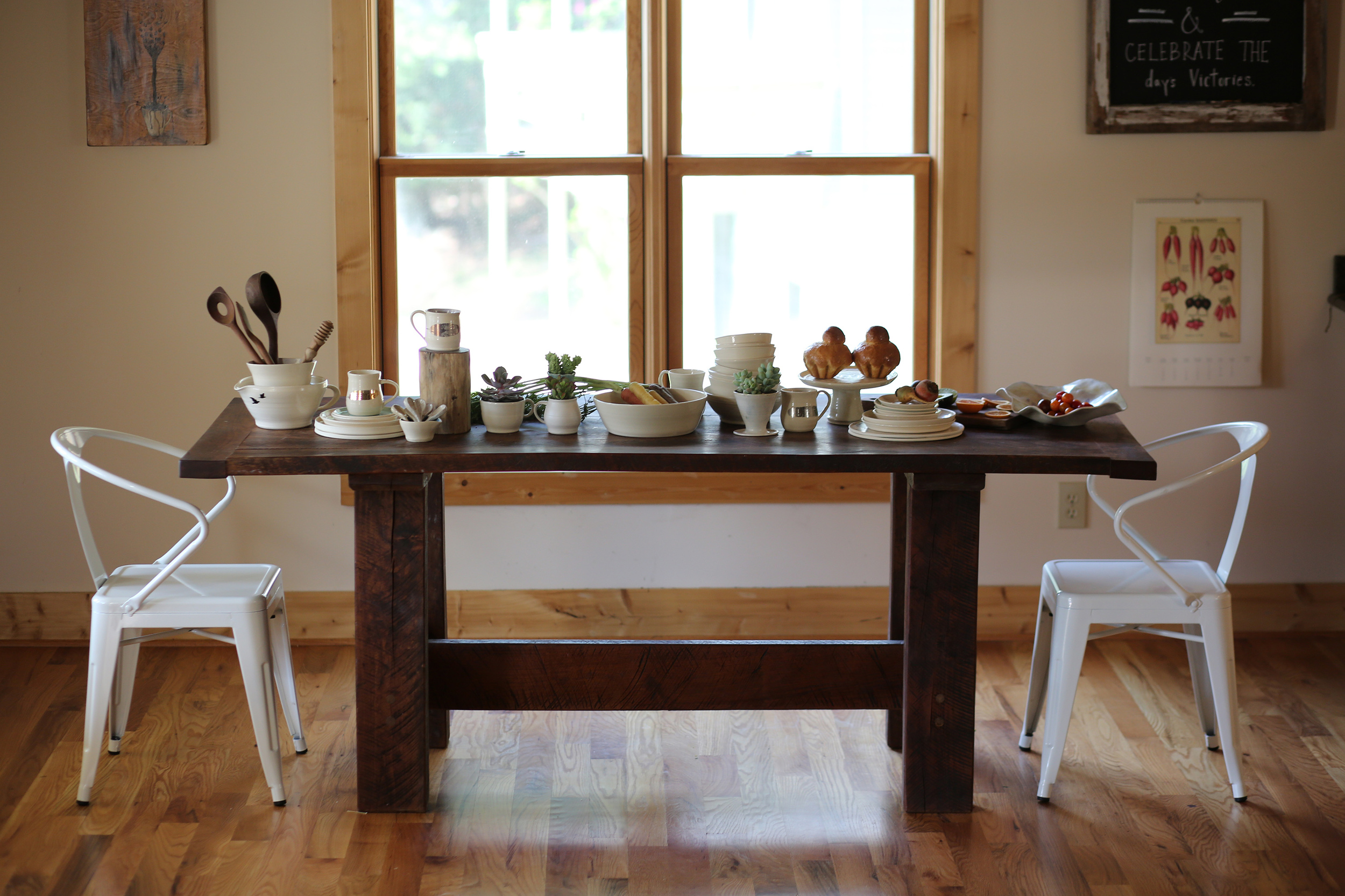 Farm table was crafted by Melina's husband and fellow artist at Overflow Studios.