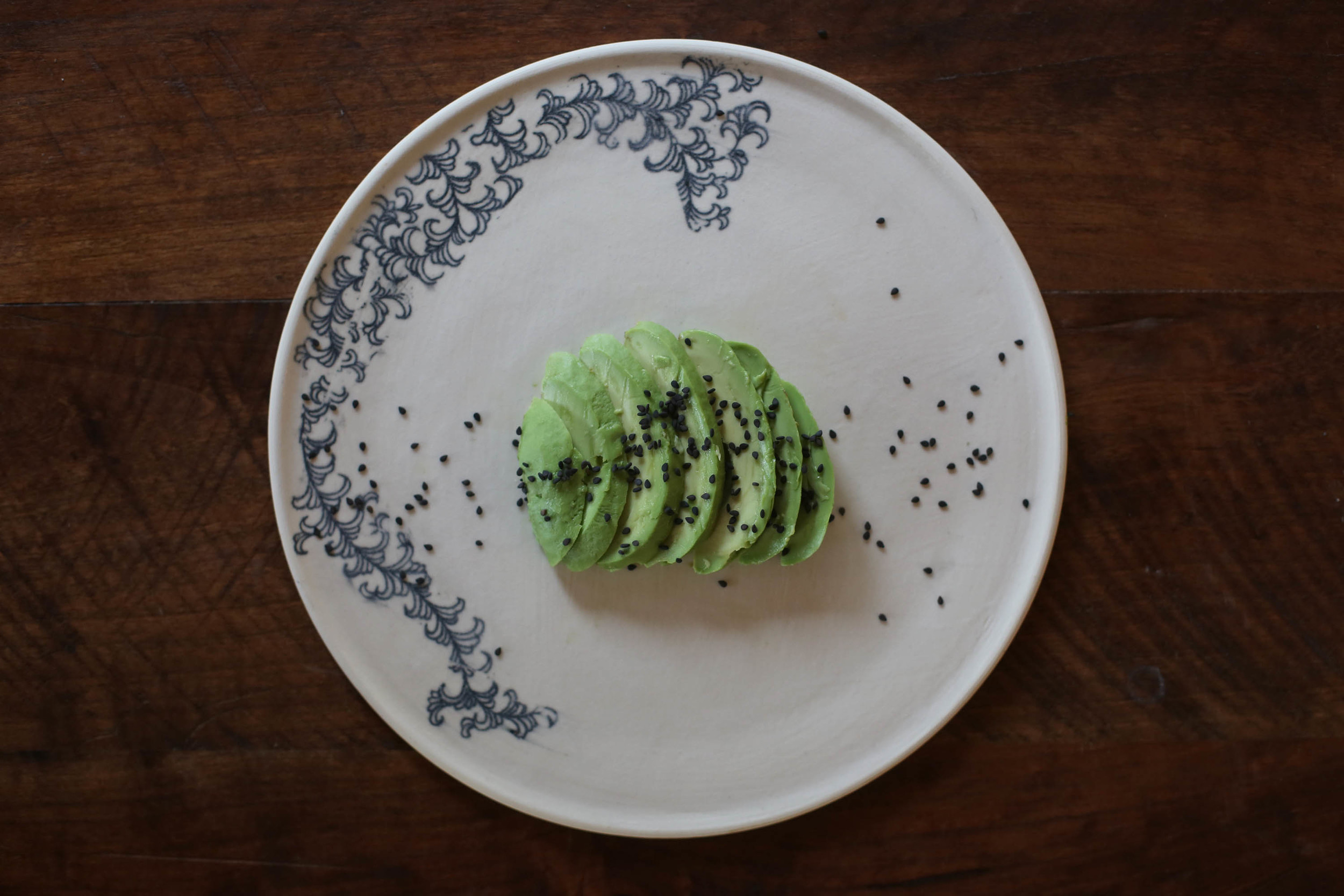 Sliced Avocado with sesame seeds.