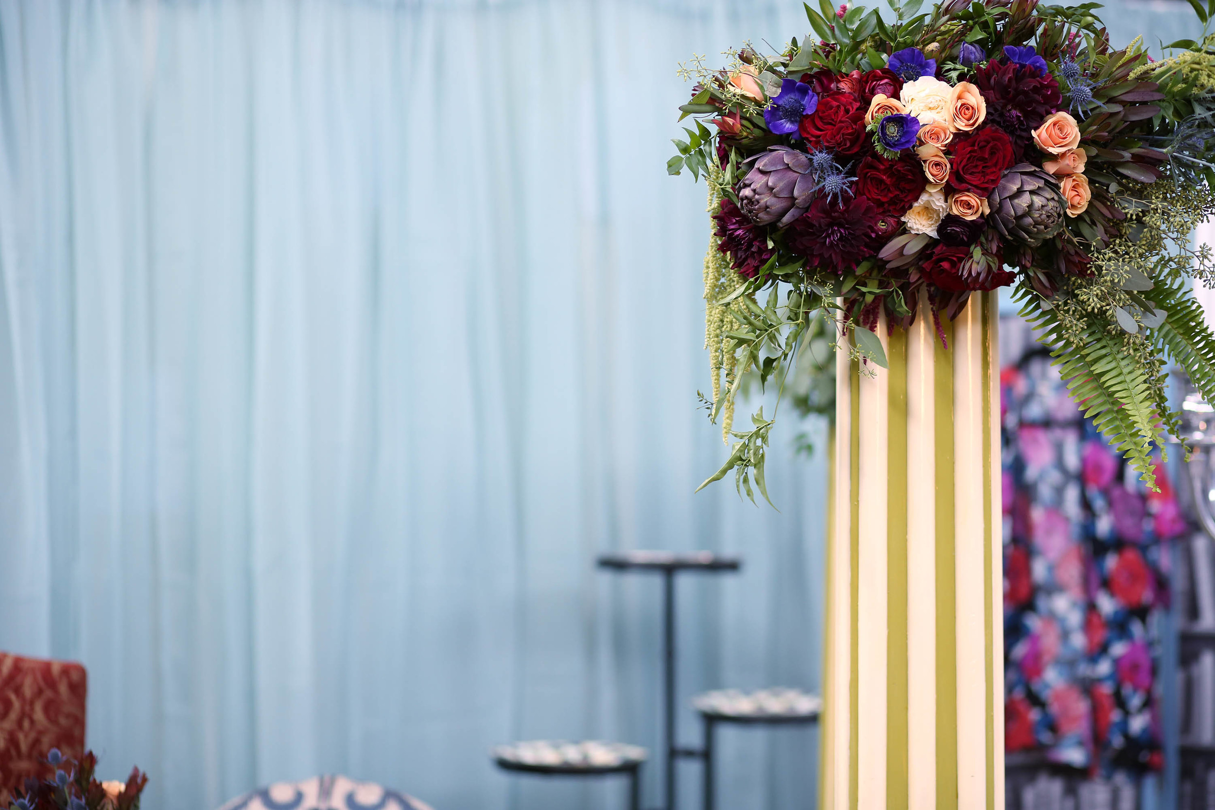 Julie killed it with the flowers. Cascading bouquets for the columns.