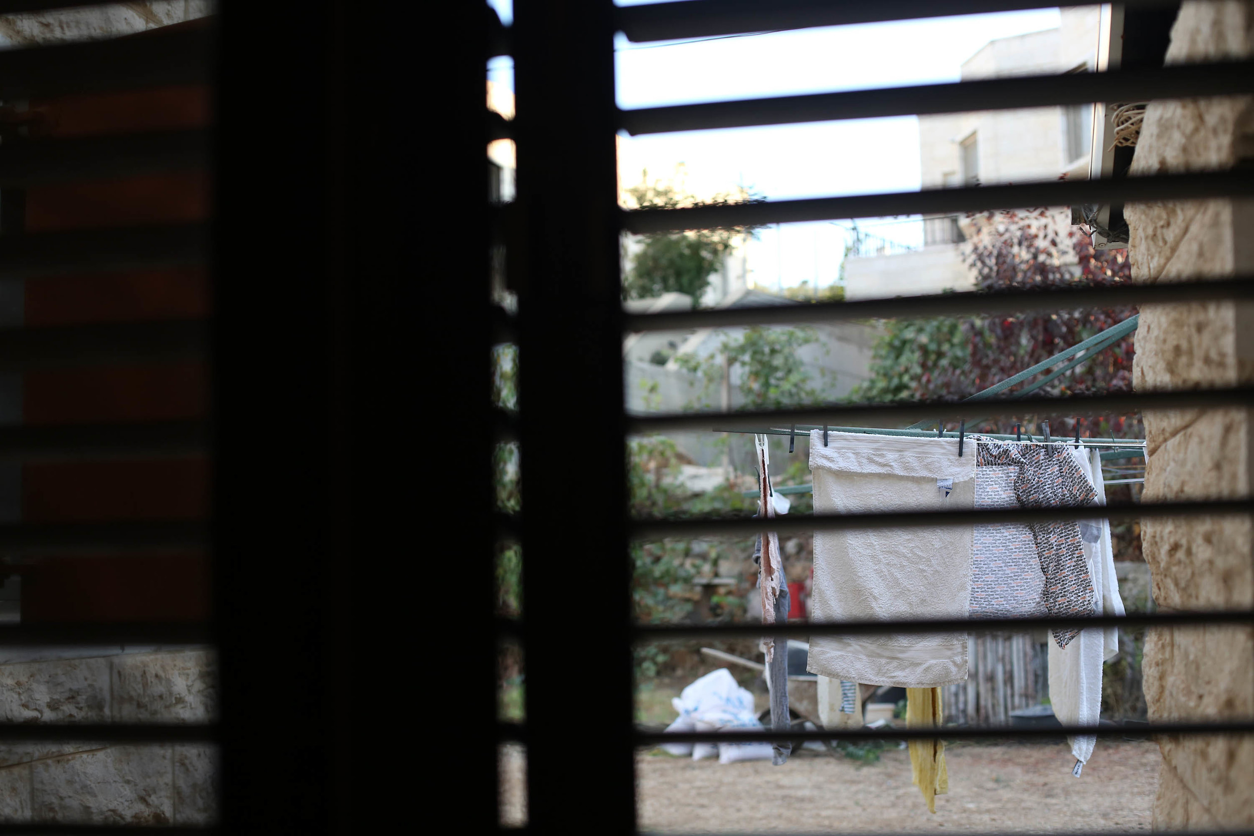 From our bedroom window, the smell of fresh laundry cascades through the shutters.