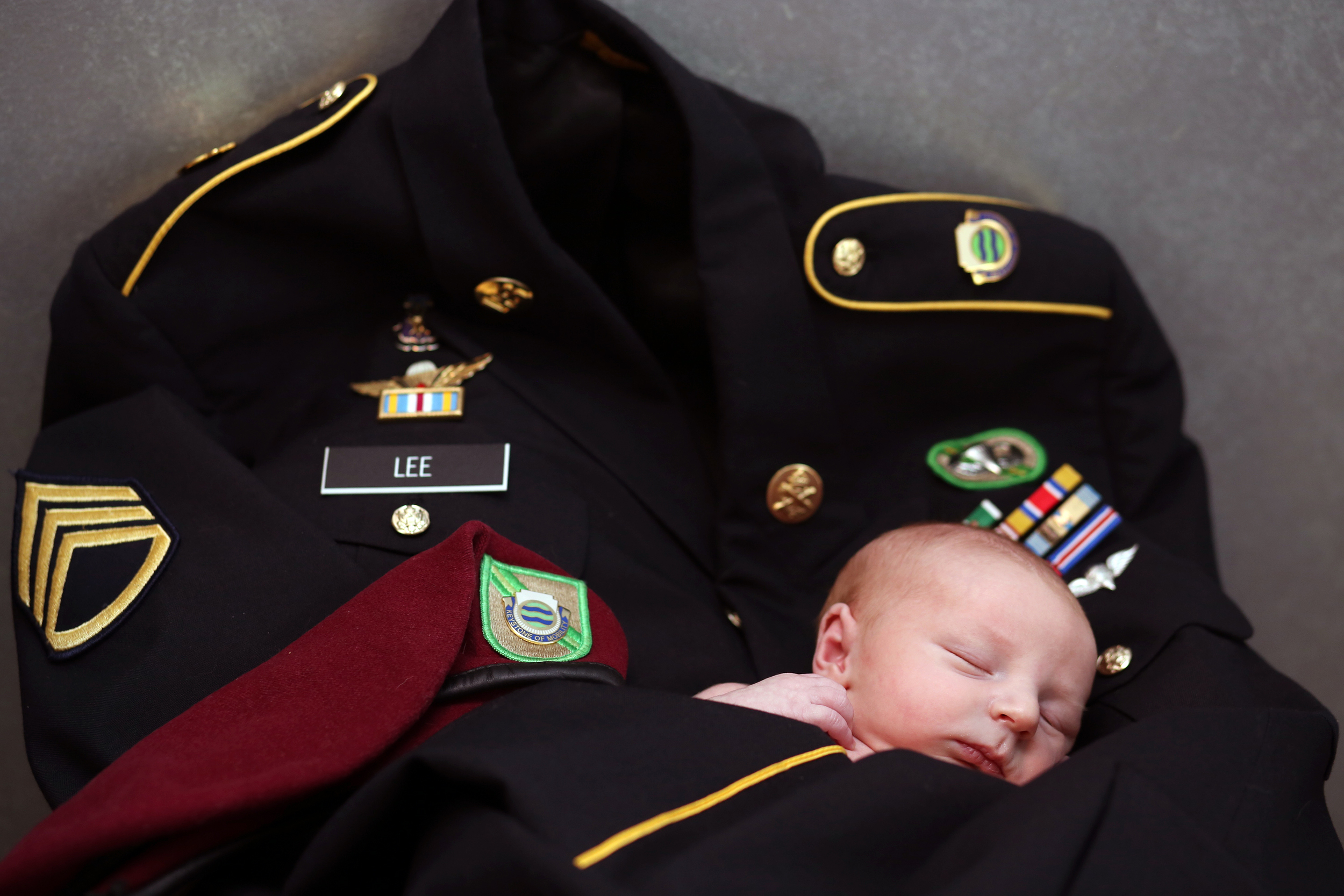 Caleb's Father's military uniform made the perfect baby blanket for snuggling.