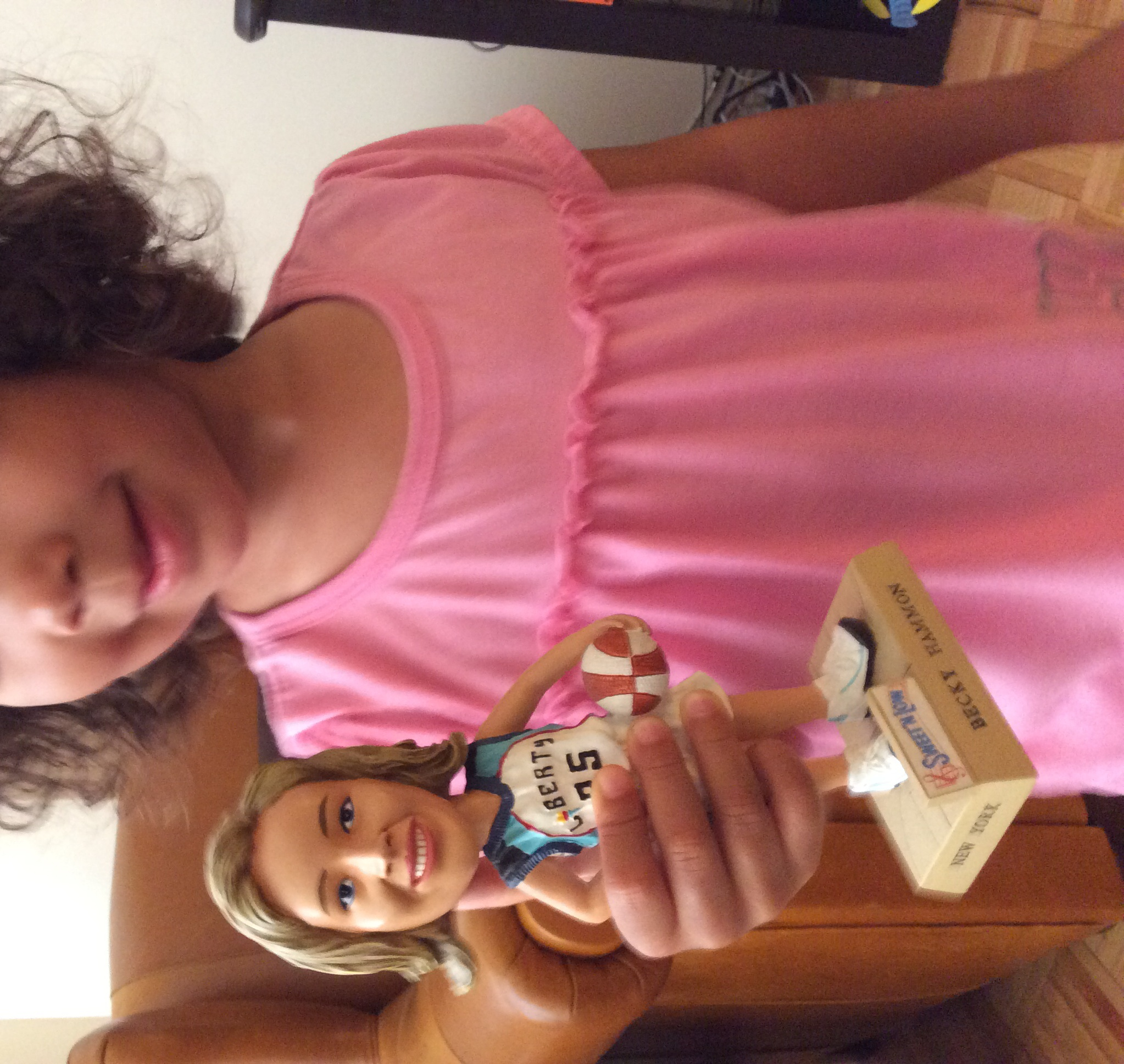 My daughter holding my old Becky Hammon bobblehead.