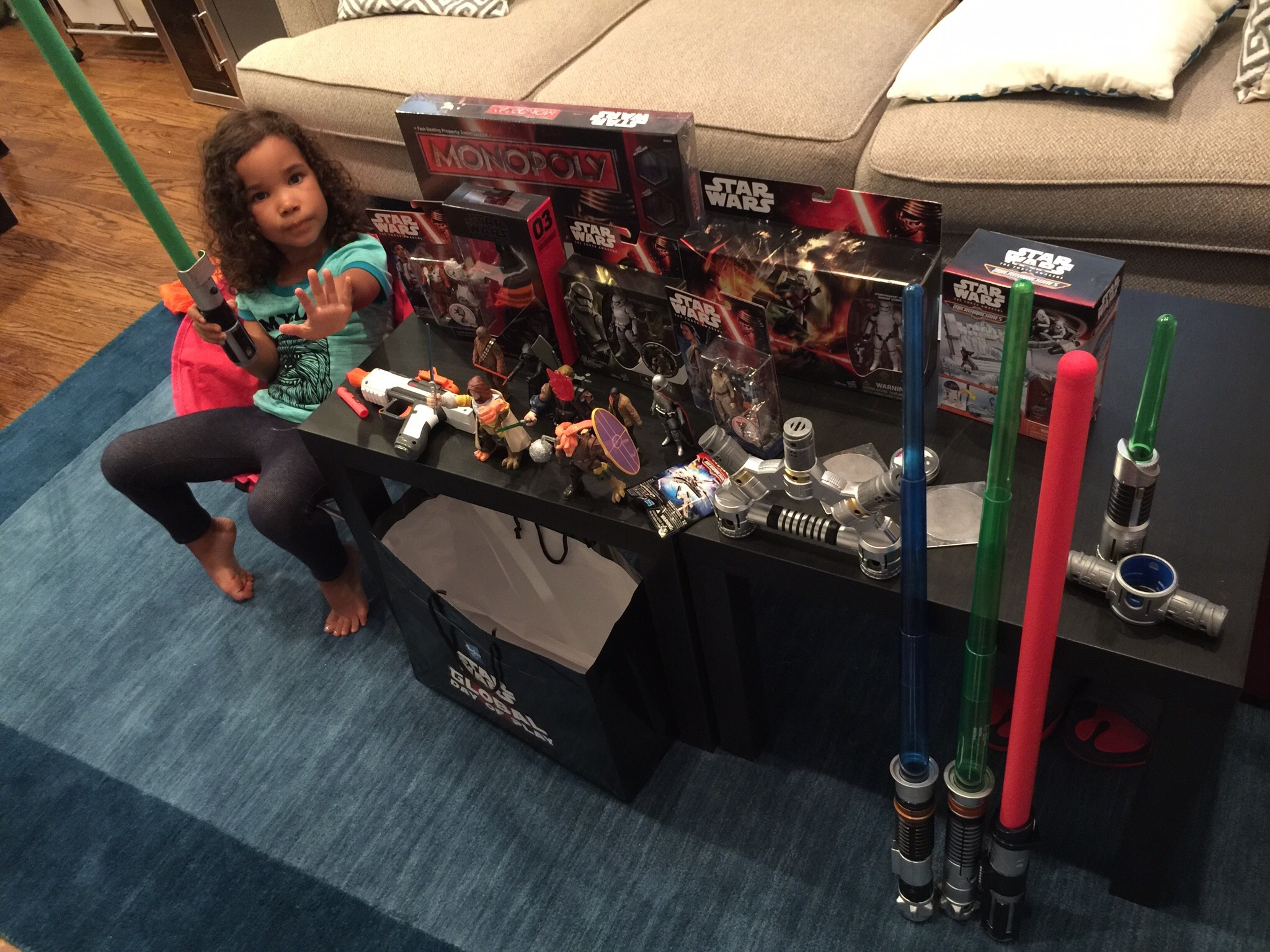Using the Force to protect her Star Wars Global Day of Play event loot from evil.