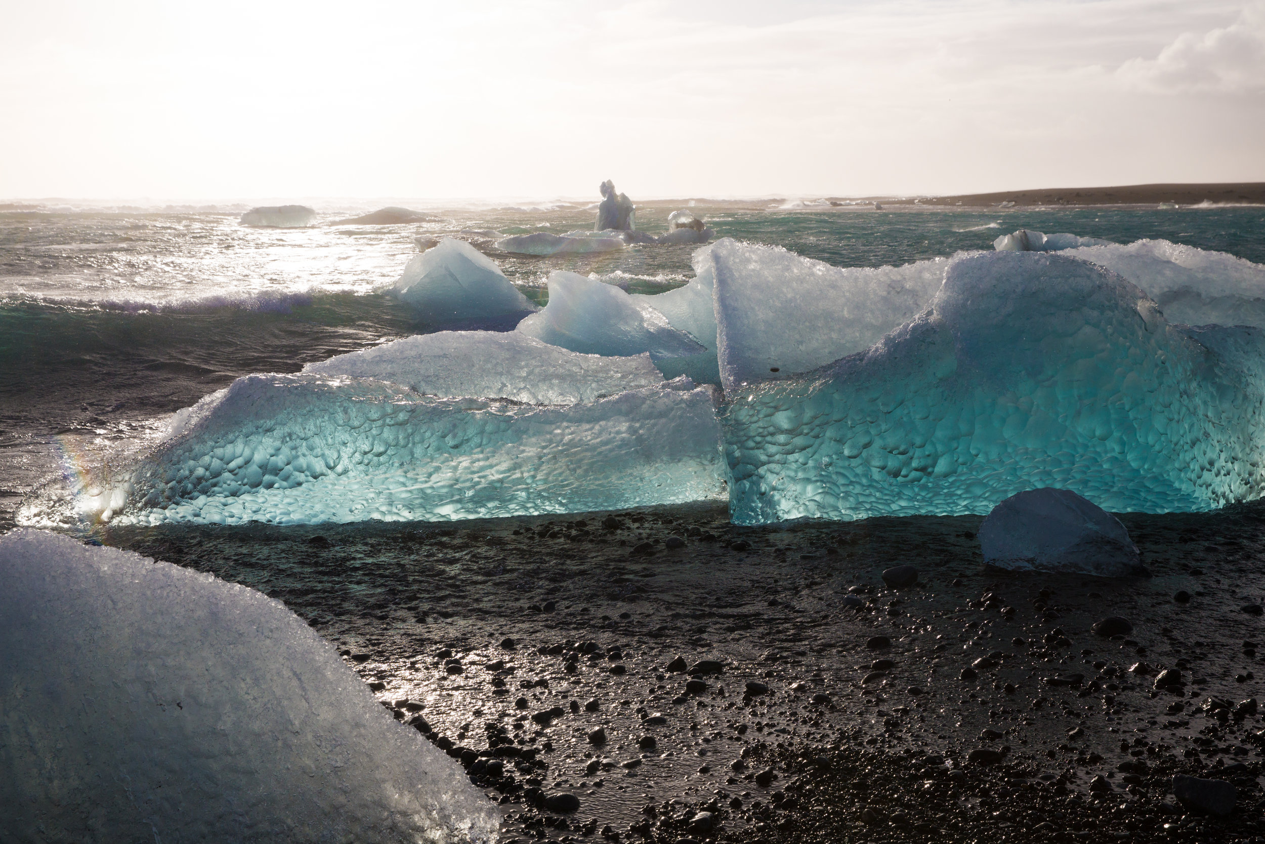 It's hard to explain the surreal feeling of watching pieces of glacier floating out to sea, and crashing on the waves of a black sand beach. Watching the blue bubbles frozen under the service look like something lives within. Science fiction lovers will be fascinated here.