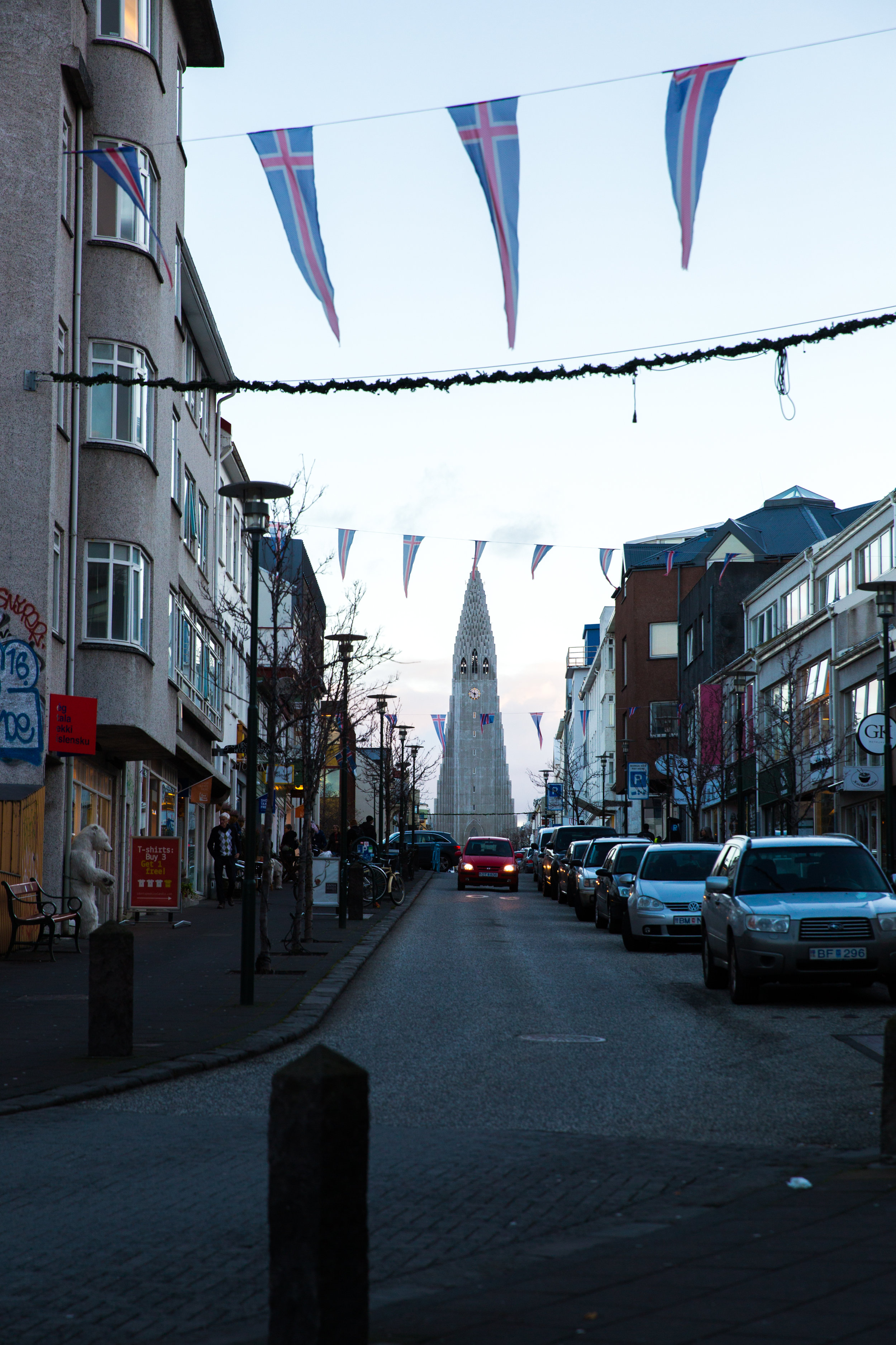 Night coming on quickly on the streets of Reykjavik. Banners to the Icelandic people wave freely throughout the streets.