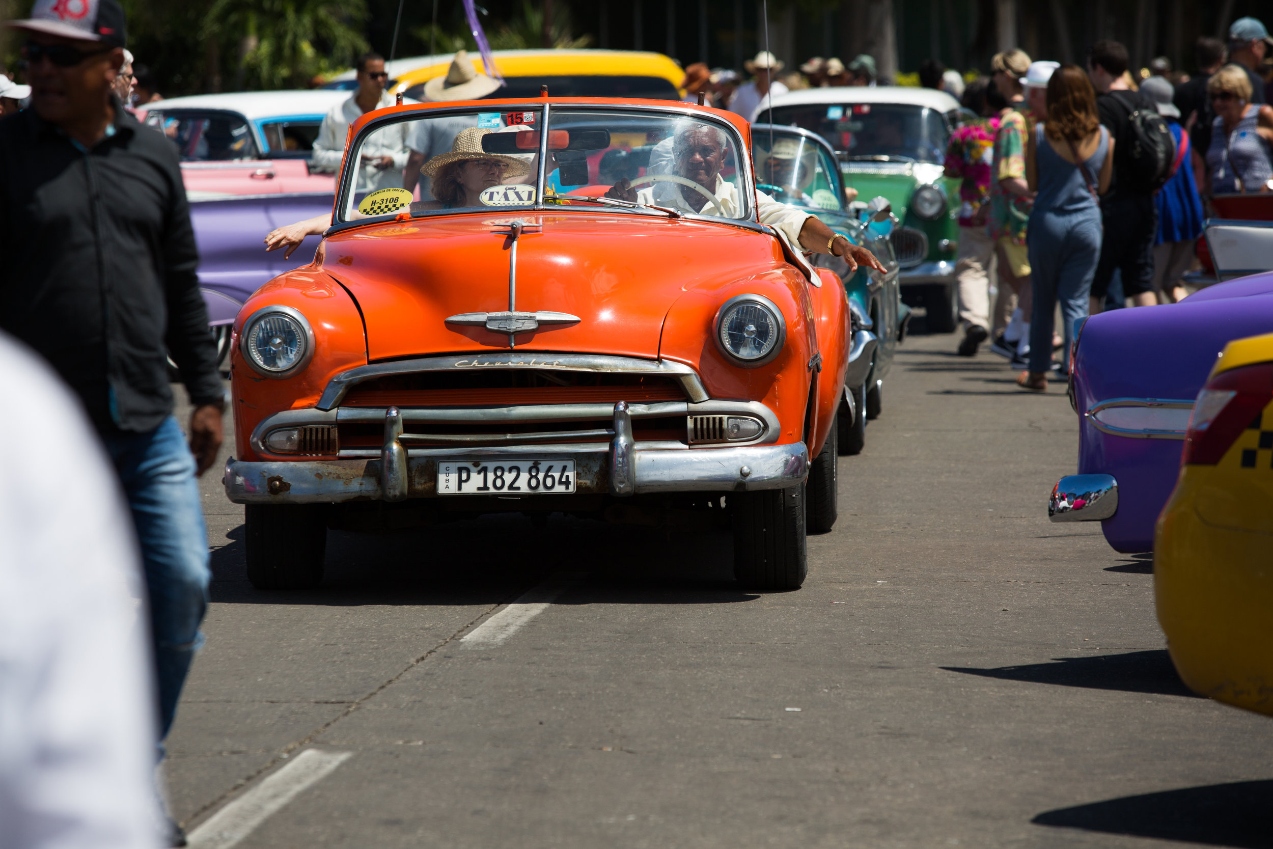Cars gather regularly in the square, and take a break while tourists of all walks admire the classics.