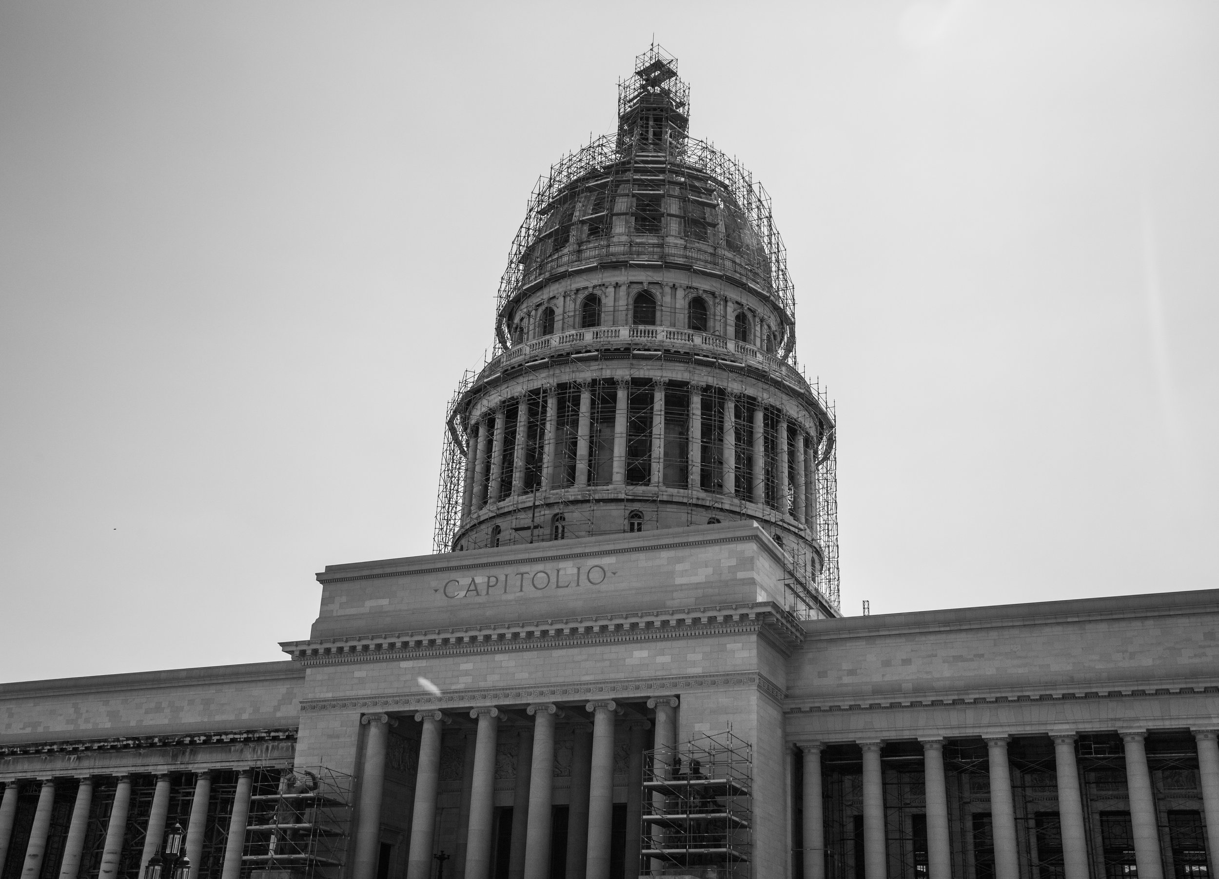 The capitol currently under renovation. notice the clean walls and pillars on the right hand side, with the left hand side next for its close up.