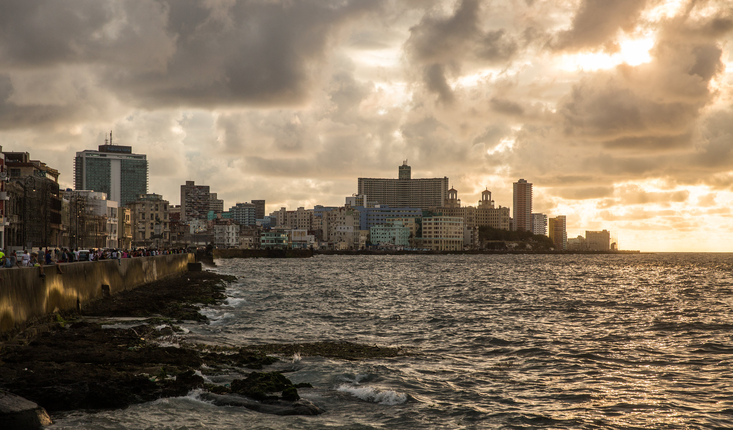 The Malecón is the most popular spot in Cuba. Crowds of people hugged the sea wall for miles to watch the sunset on a warm Sunday evening.