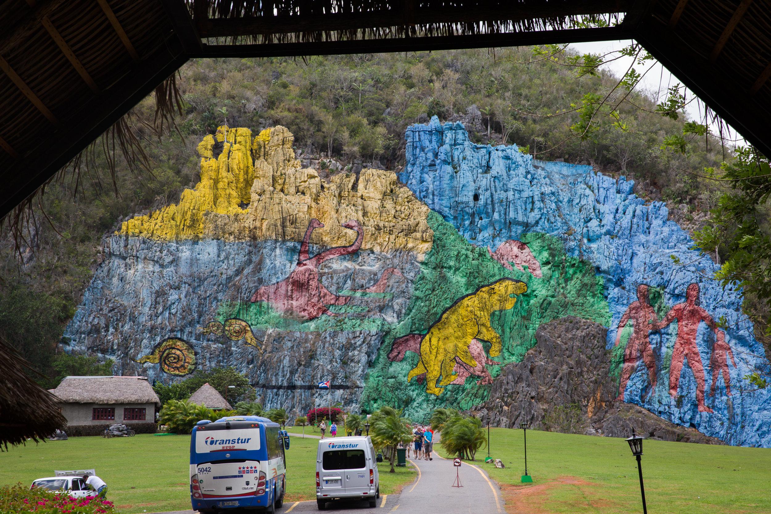 The Mural de la Prehistoria walks us through a chart of evolution in vivid color.