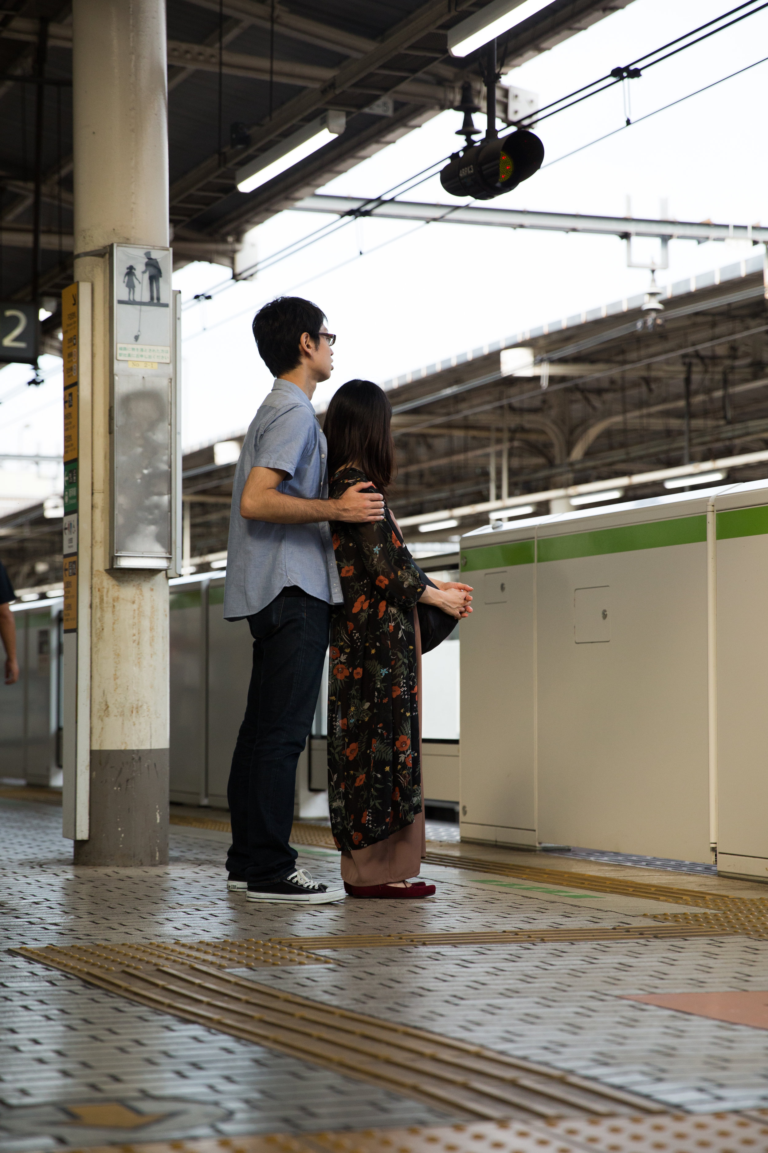 ' Lady Brown ' by Nujabes | A couple waits for a train back to Shibuya.