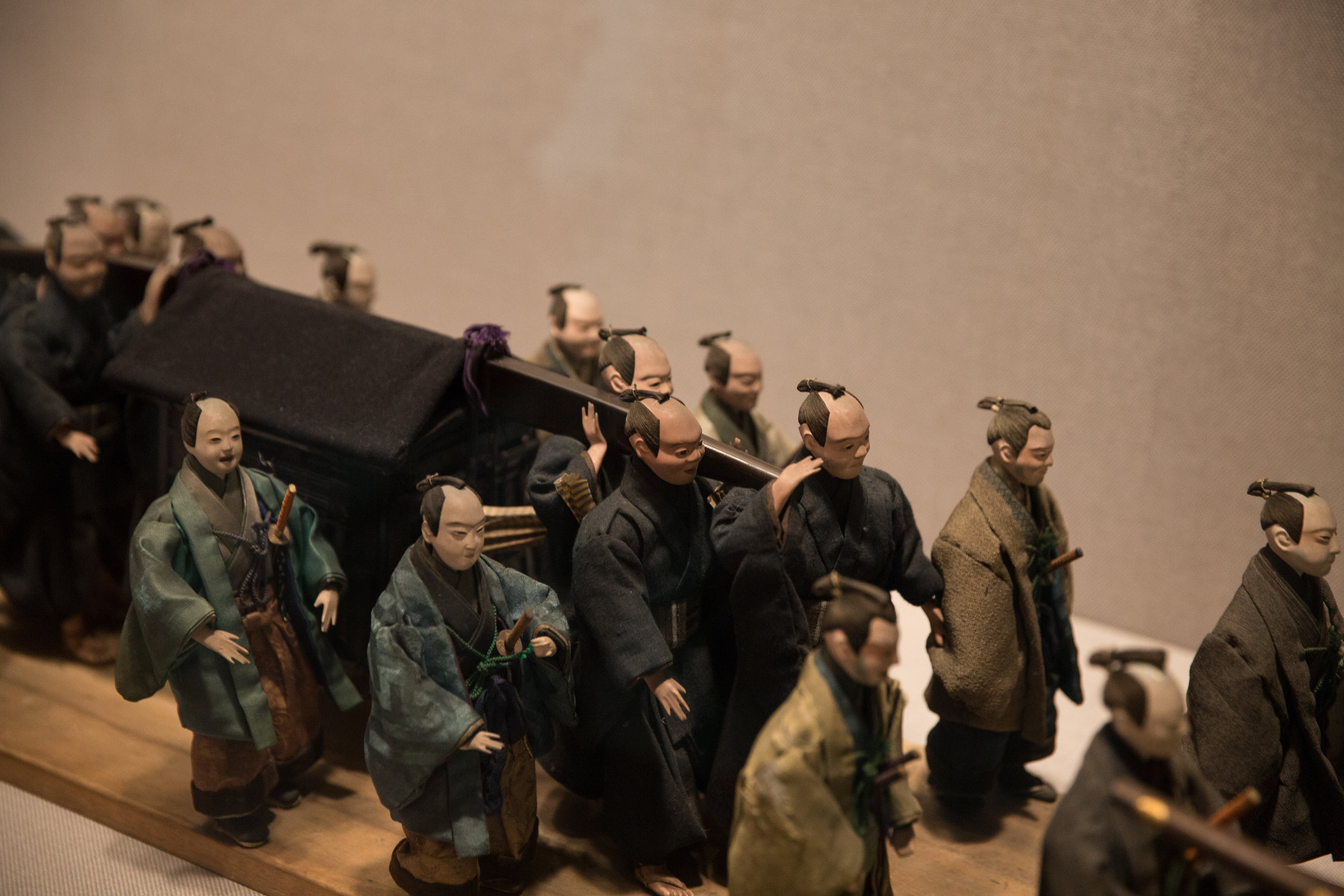 A daimyo (feudal lord) doll procession with stunning detail. These stood about 4 inches tall.