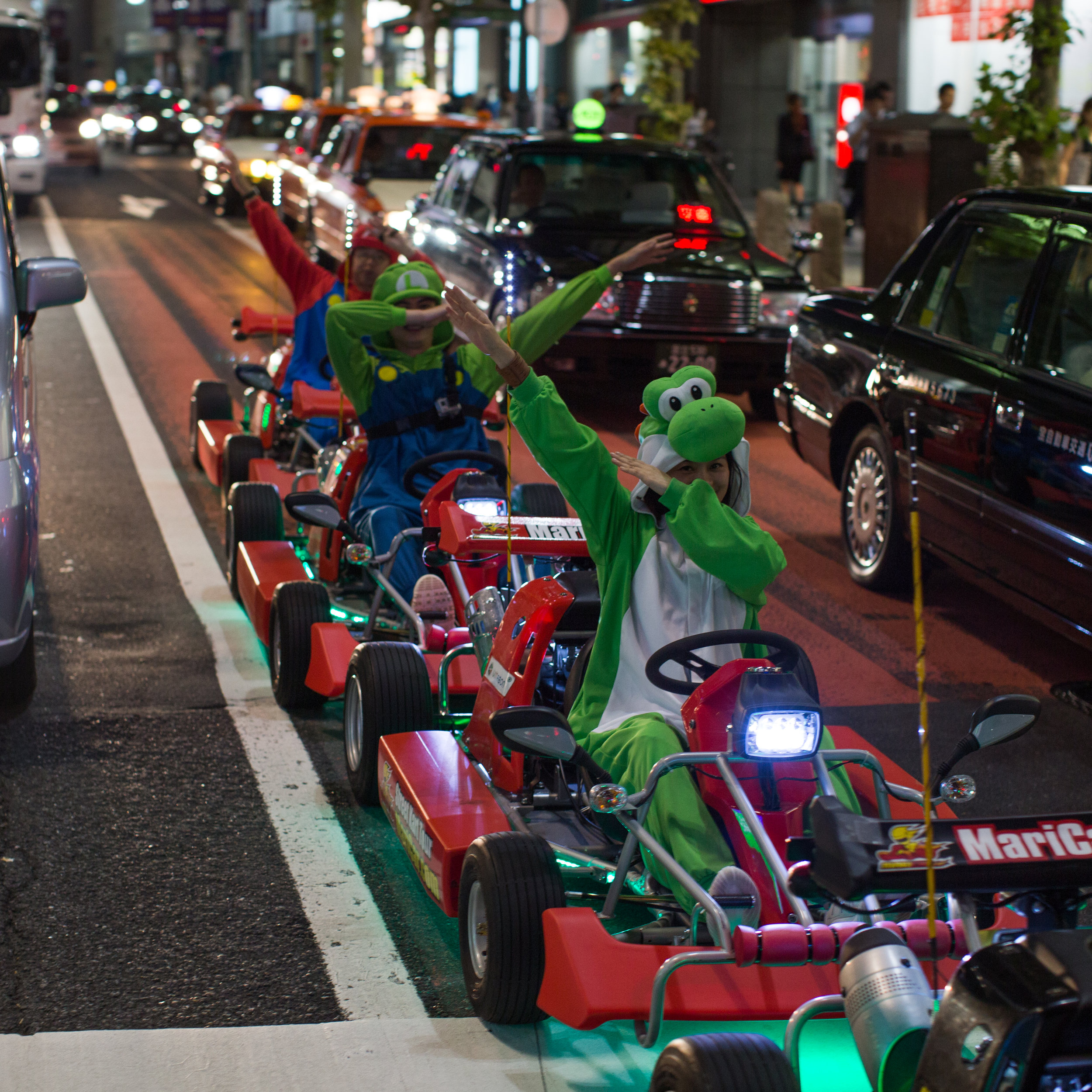 A Mario Cart city tour dabs on traffic for me on the streets of Shibuya.