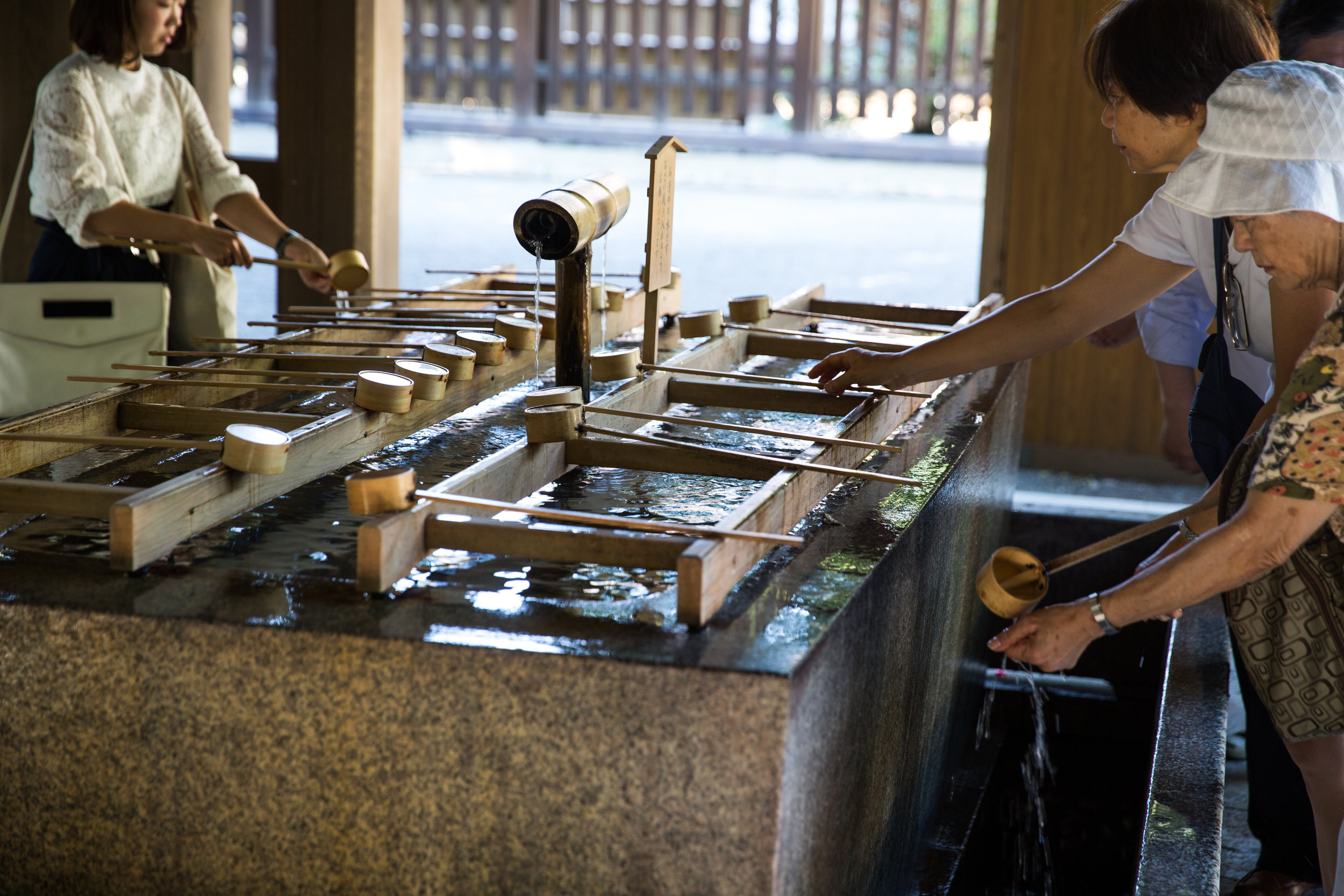 Visitors gather to wash their hands before prayer in the shrine.
