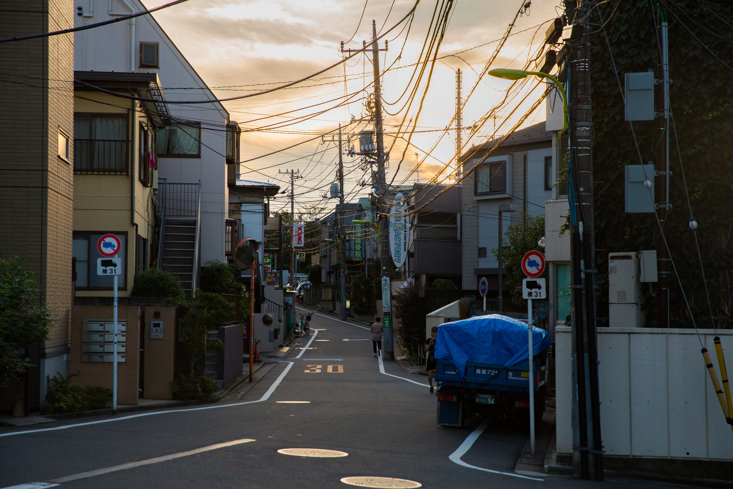 We can't remember exactly, but it was around here when we realized how familar this part of town looked. Finally we realized, after decades in the United States watching anime, that the cities you see in daily life anime were not fictional, but instead gorgeous pathways among quiet neighborhoods.
