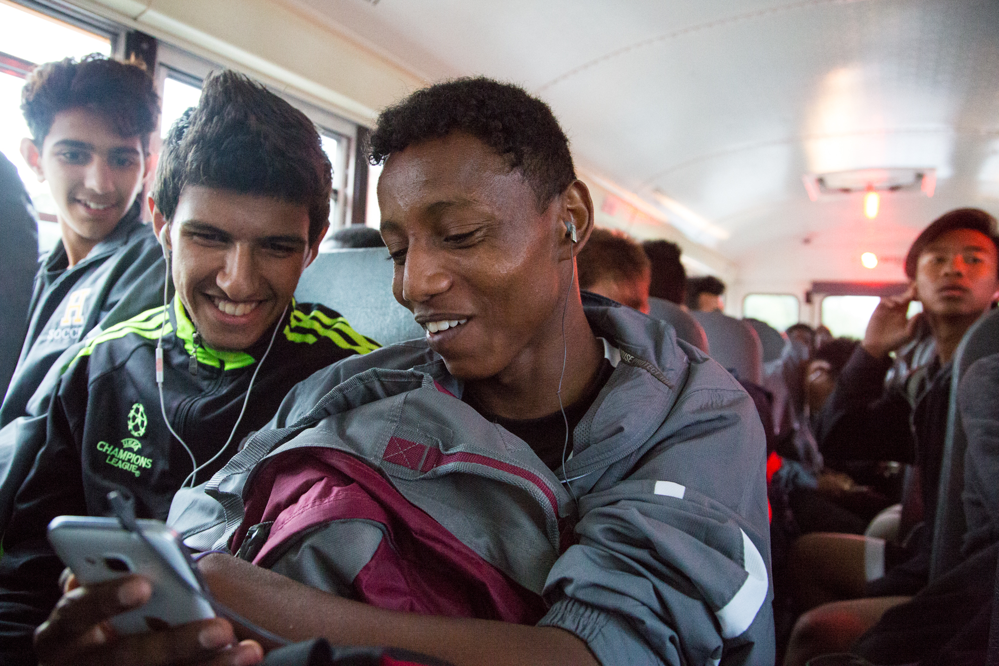 Ramadan Saad, from Somalia shows Sajad Modric, a junior varsity player a song on his phone. Ramadan doesn't speak English and hence Ahmed (extreme left) mostly helps with translating during the game and also when he needs medical assistance.