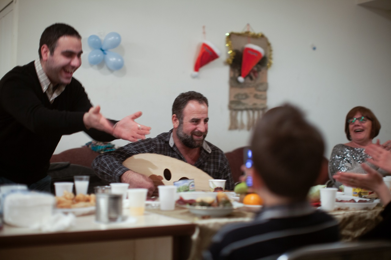 Syrian refugees in Armenia celebrating the holidays. Photo credit Eric Grigorian on assignment for the Armenian Redwood Project
