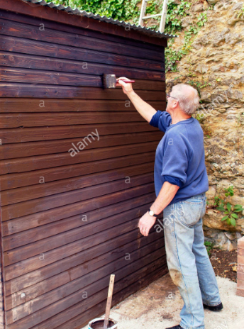 man painting shed.png