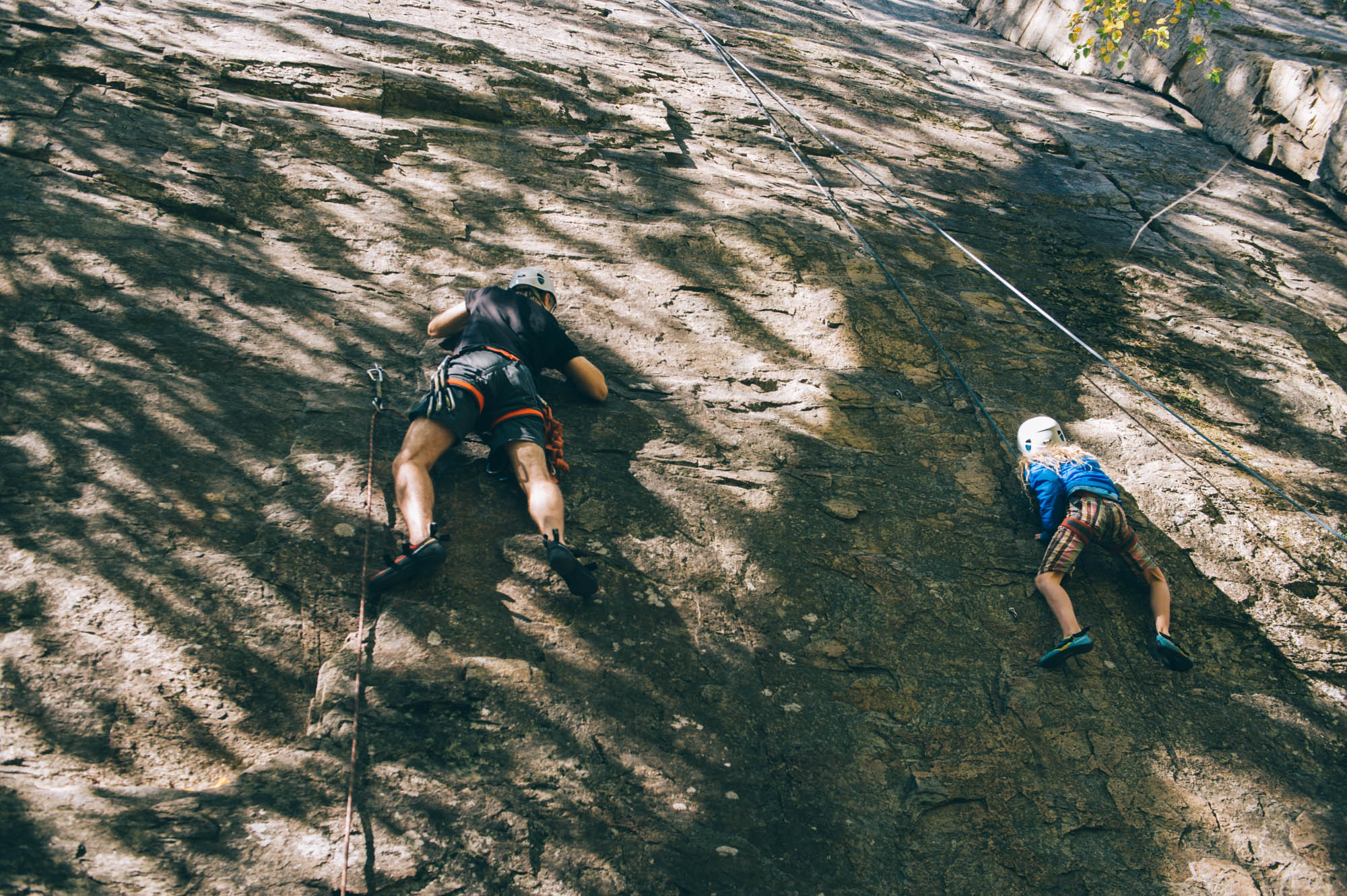 You can see here that Karl is lead climbing and Ellie is top roping (explanations below).