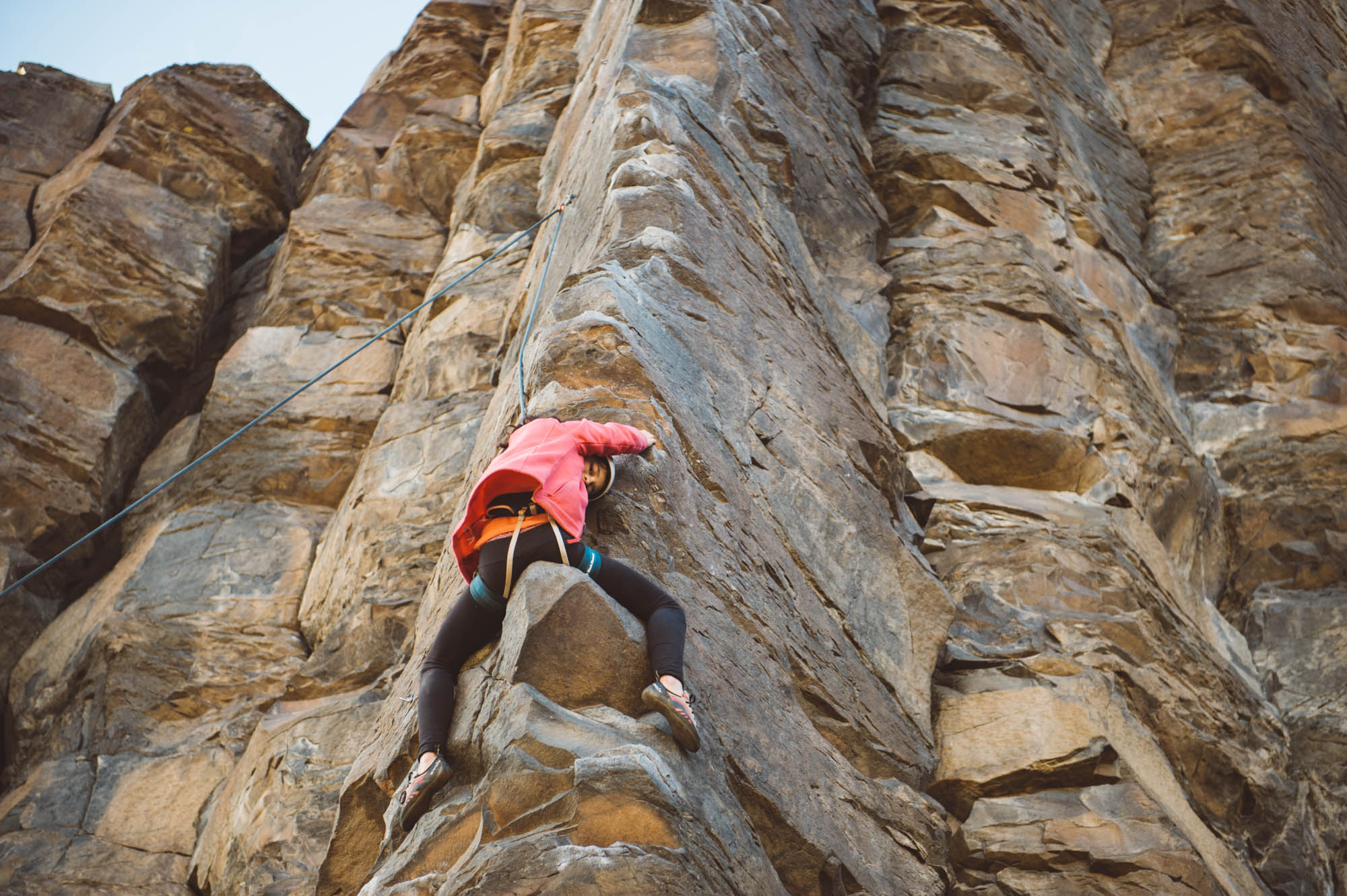 """Mara sitting on the """"saddle"""" of Ride 'em Cowboy (5.9+), one of the most popular route on this crag. There are always line ups here on the weekends!"""