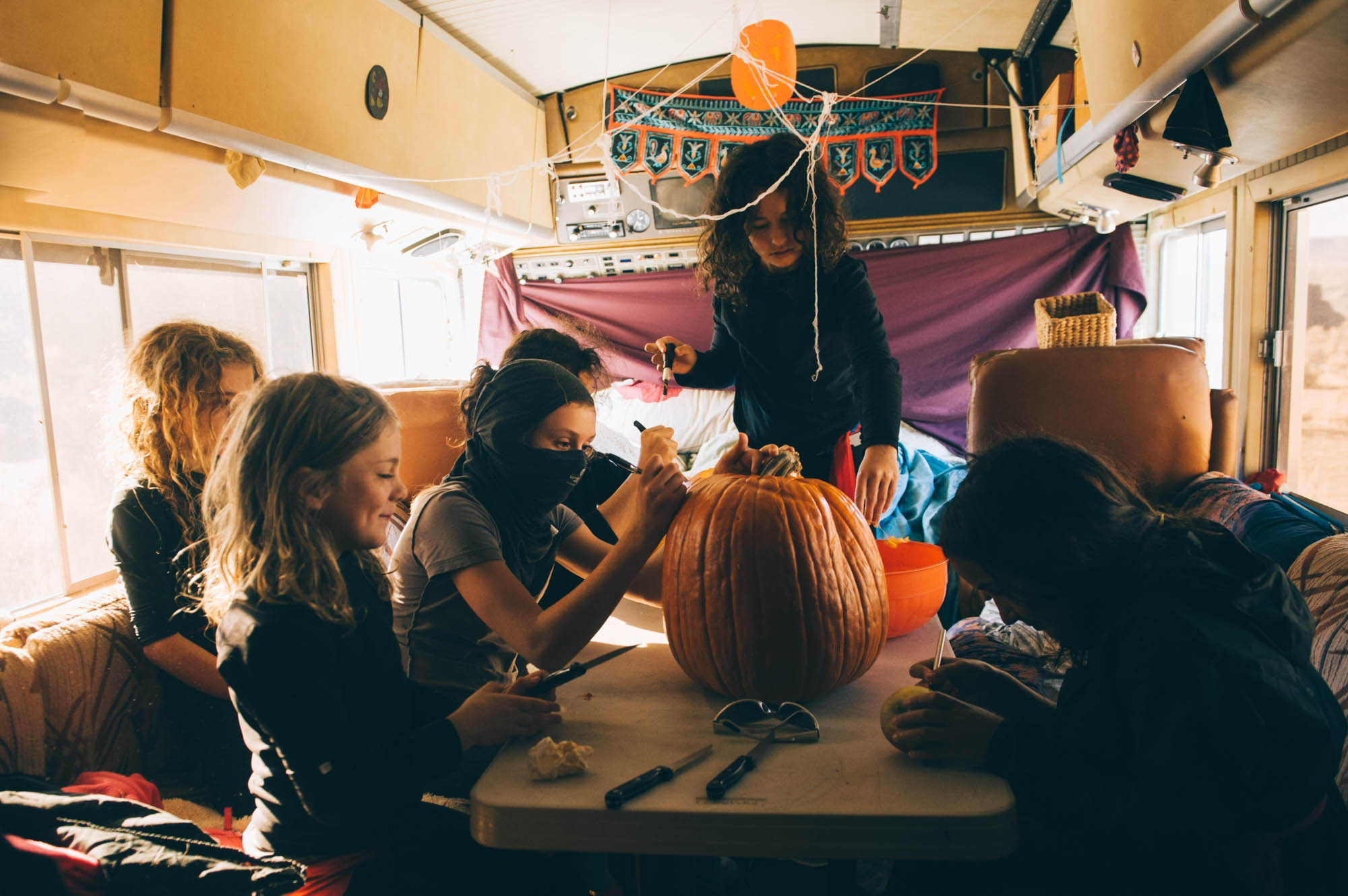 The wind was so crazy that day, we had to move the ninjas inside to finish the pumpkin carving... It was like a desert-storm, sand whisking our faces and all. The ninja costume was perfect!