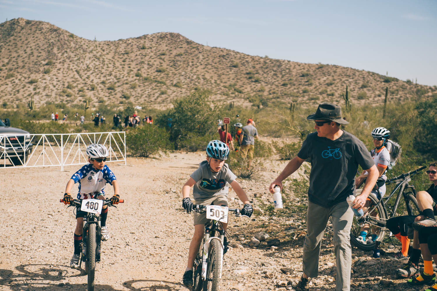 Diedra and Jason's sons were also racing. Jason was their support for the race. Here he is offering water to Charlie.