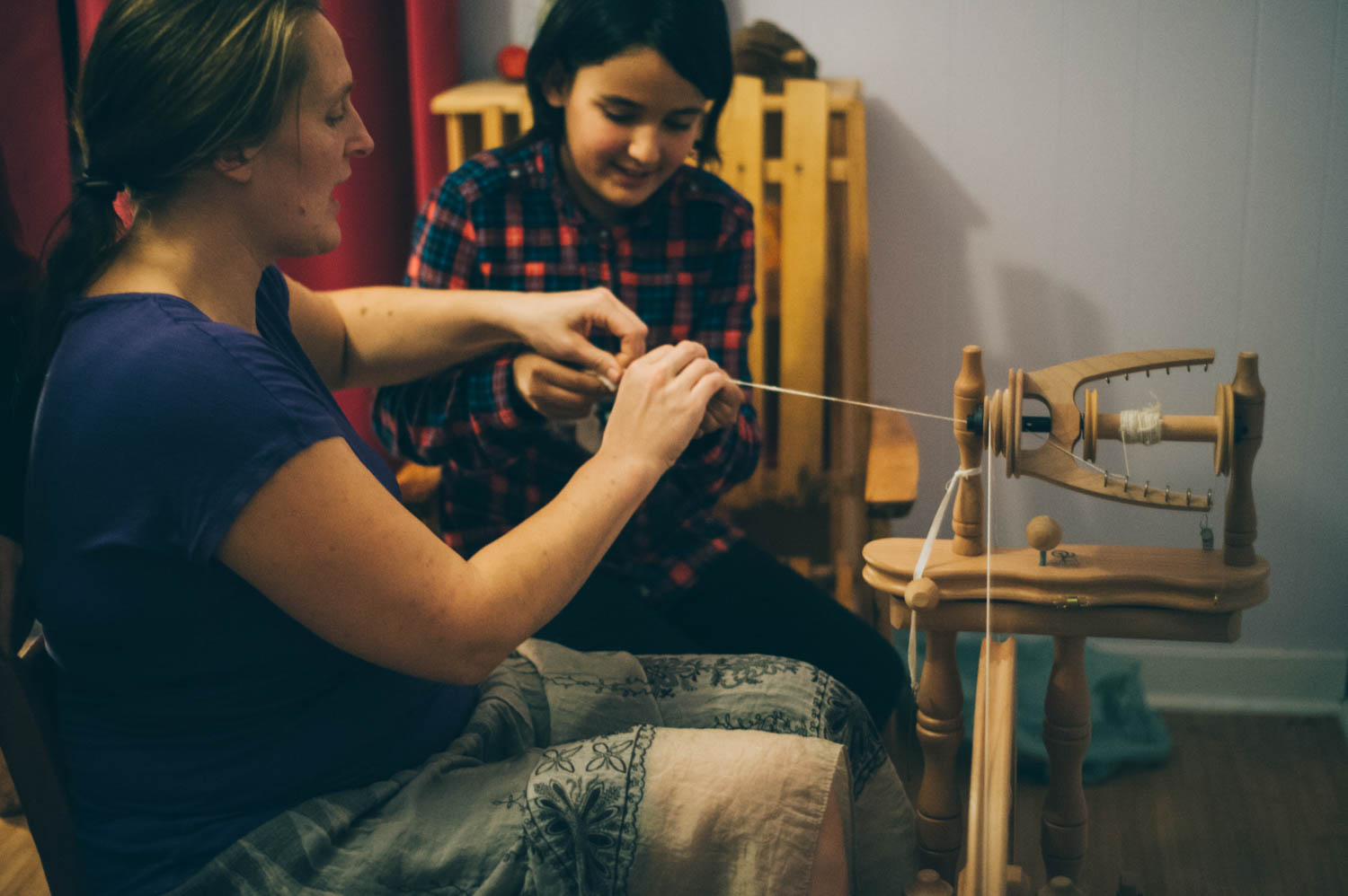 Learning to spin angora rabbit wool.