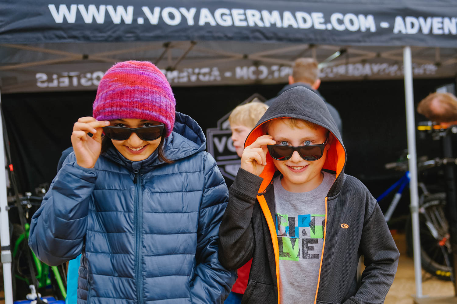 """Kids hiked up on samples of energy bars and hydration drinks,enjoying the free race swag they got """"in town""""."""