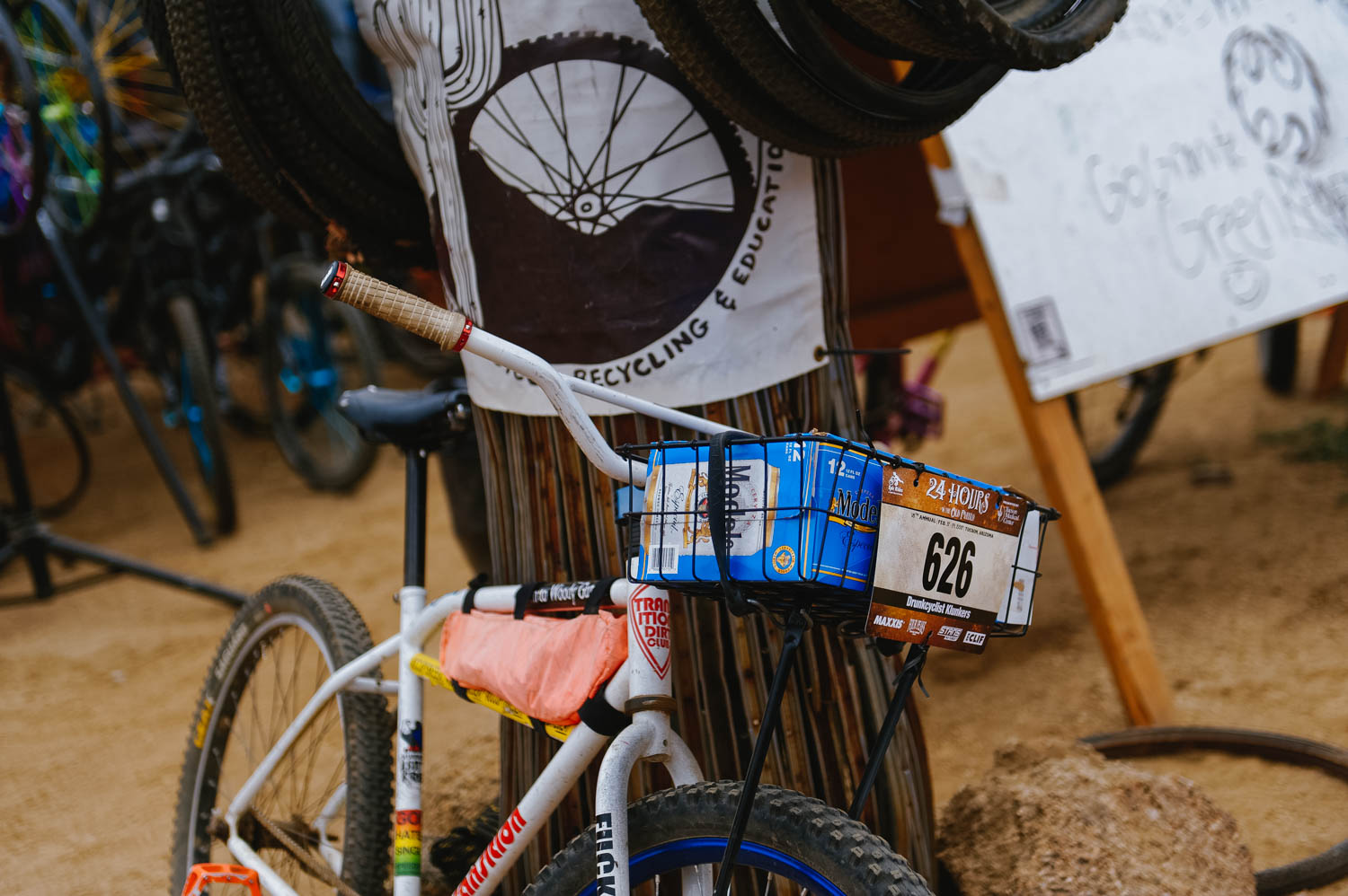Single-speed rigid bike with a 12 pack of beer. To each their race.