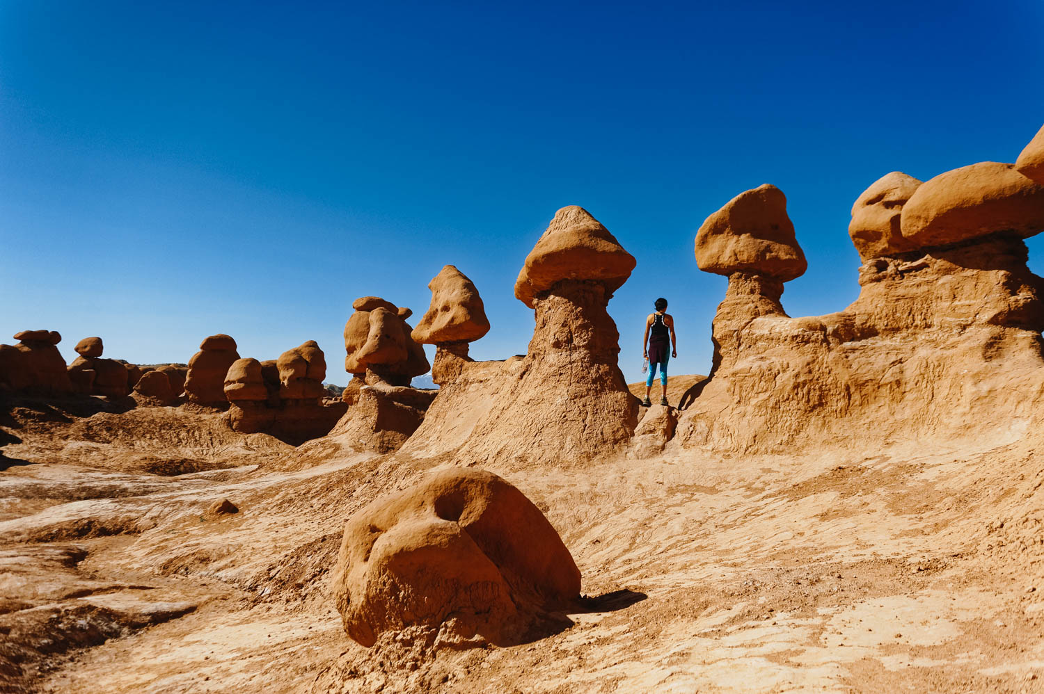 Walking through Goblin Valley is a must! Go early or even better, at sunset, to beat the crowd.
