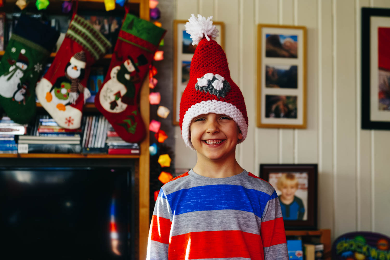 Rafael sporting a Christmas Paw Patrol hat the girls made
