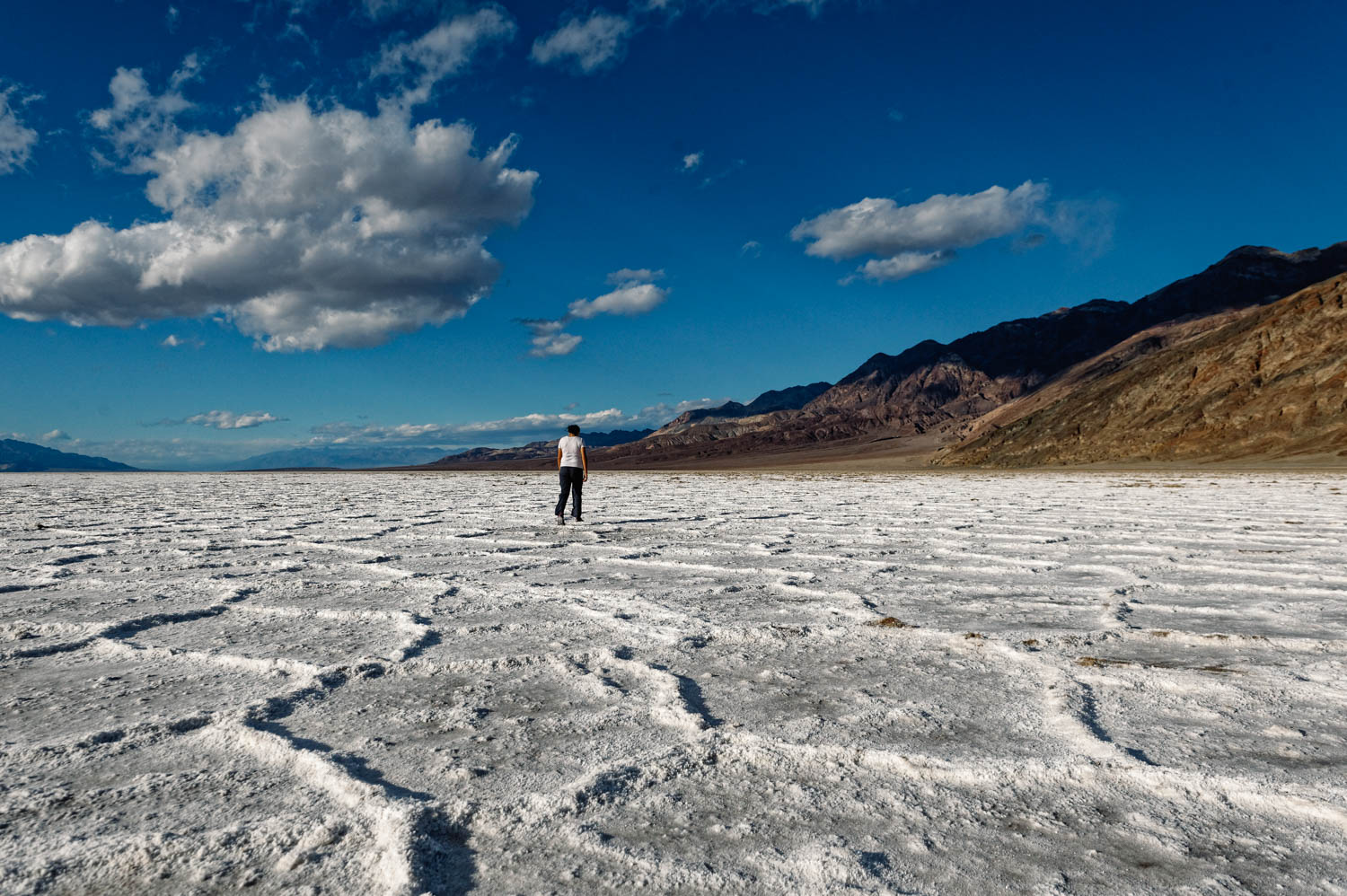 Most people know that Badwater Basin in Death Valley National Park is the lowest point in North America (282 ft below sea level), but there's something even more fascinating about that place. When rainstorms flood the valley bottom like it did in the last few weeks, the salt expanse is covered with a thin sheet of standing water. Each newly-formed lake does not last long, because the 1.9 inches of average rainfall is overwhelmed by a 150-inch annual evaporation rate. This means that even a 12-foot-deep, 30-mile-long lake would dry up in a single year!!! How crazy is that?