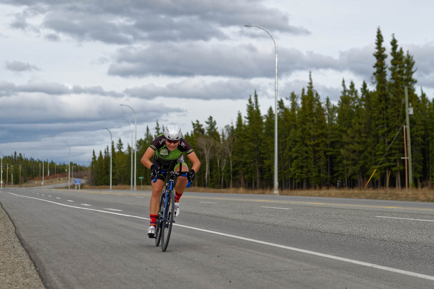 Final sprint in her first Time Trial on the Alaska Highway. Can't hide the mountain biker position yet! Much learning to do in this new discipline.
