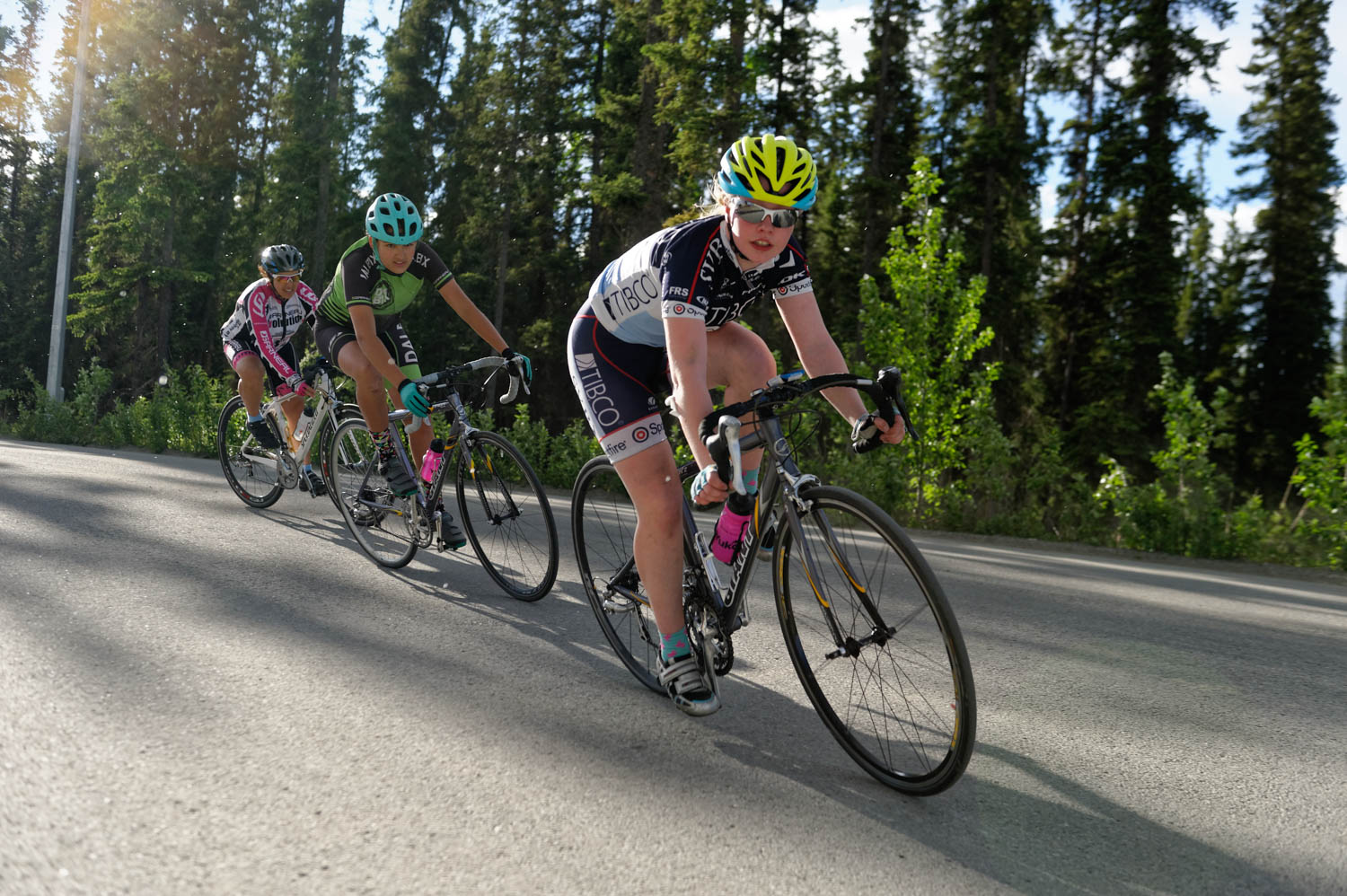 Tori, Mathilde and coach Trena racing the Crit on Friday night.