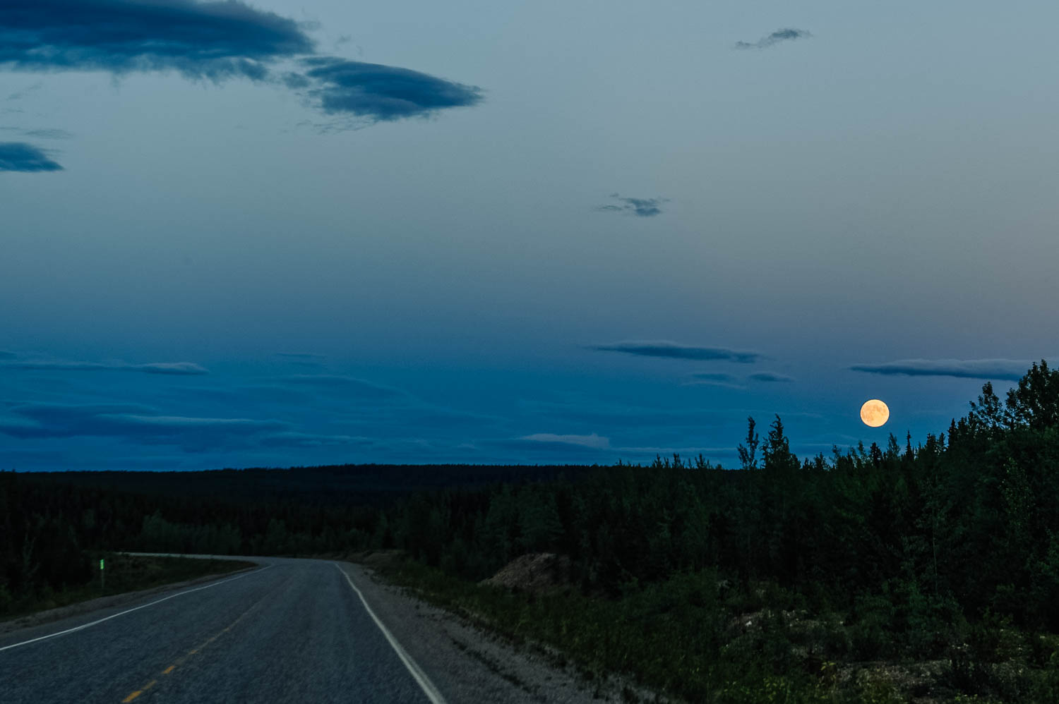 Full moon rising over the Stewart-Cassiar Highway.