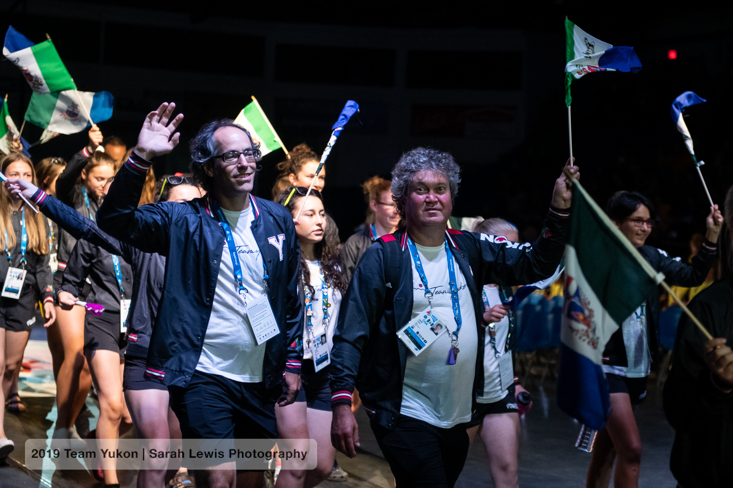 JF and Dean the mechanic (with Aïsha behind him and Mathilde at the far right) entering the arena with the Yukon delegation during the opening ceremonies.