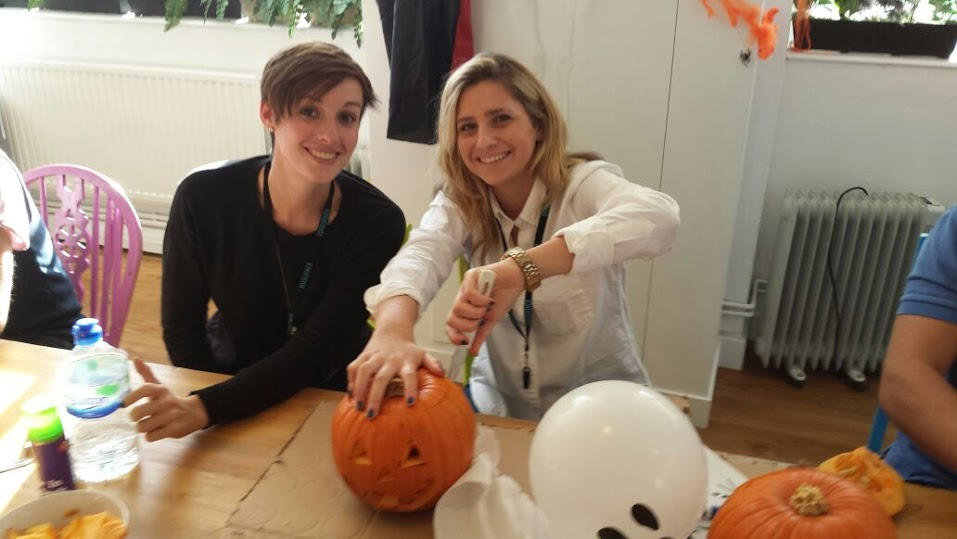 Holly and Tash pumpkin carving on Halloween