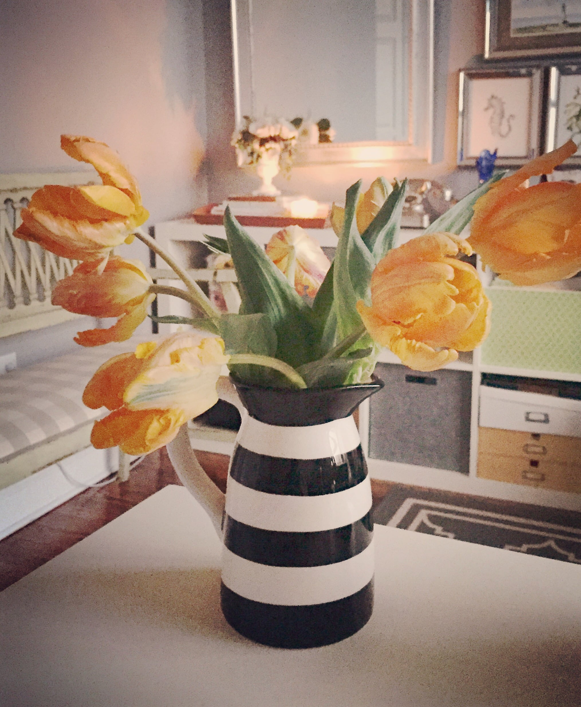 It's cozy in my studio with a few tulips and a $3 striped pitcher from Target!