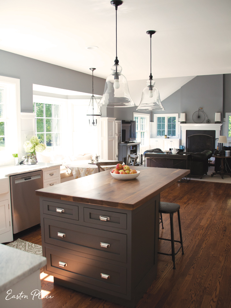 The island now has more storage space, and the custom walnut top, from  Lorimer Studio , adds warmth to the area. (Duluth Pulls by Restoration Hardware)