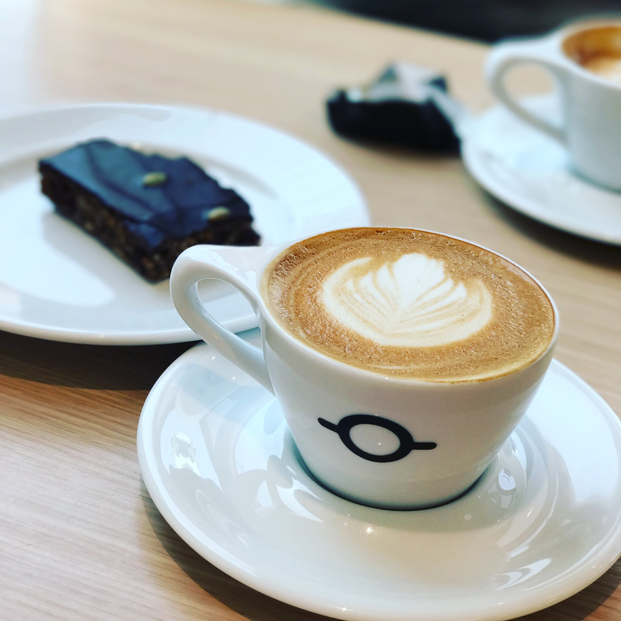Cappuccino with oat milk and a vegan brownie at our favorite spot Te & Kaffi