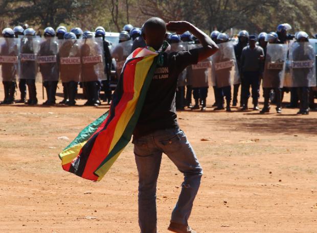 zimbabwe-riots-mugabe-.png