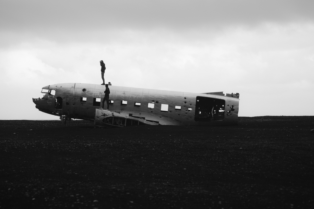 The incredible, abandoned plane on the black sands of Iceland. Photographed by Sandy Noto.