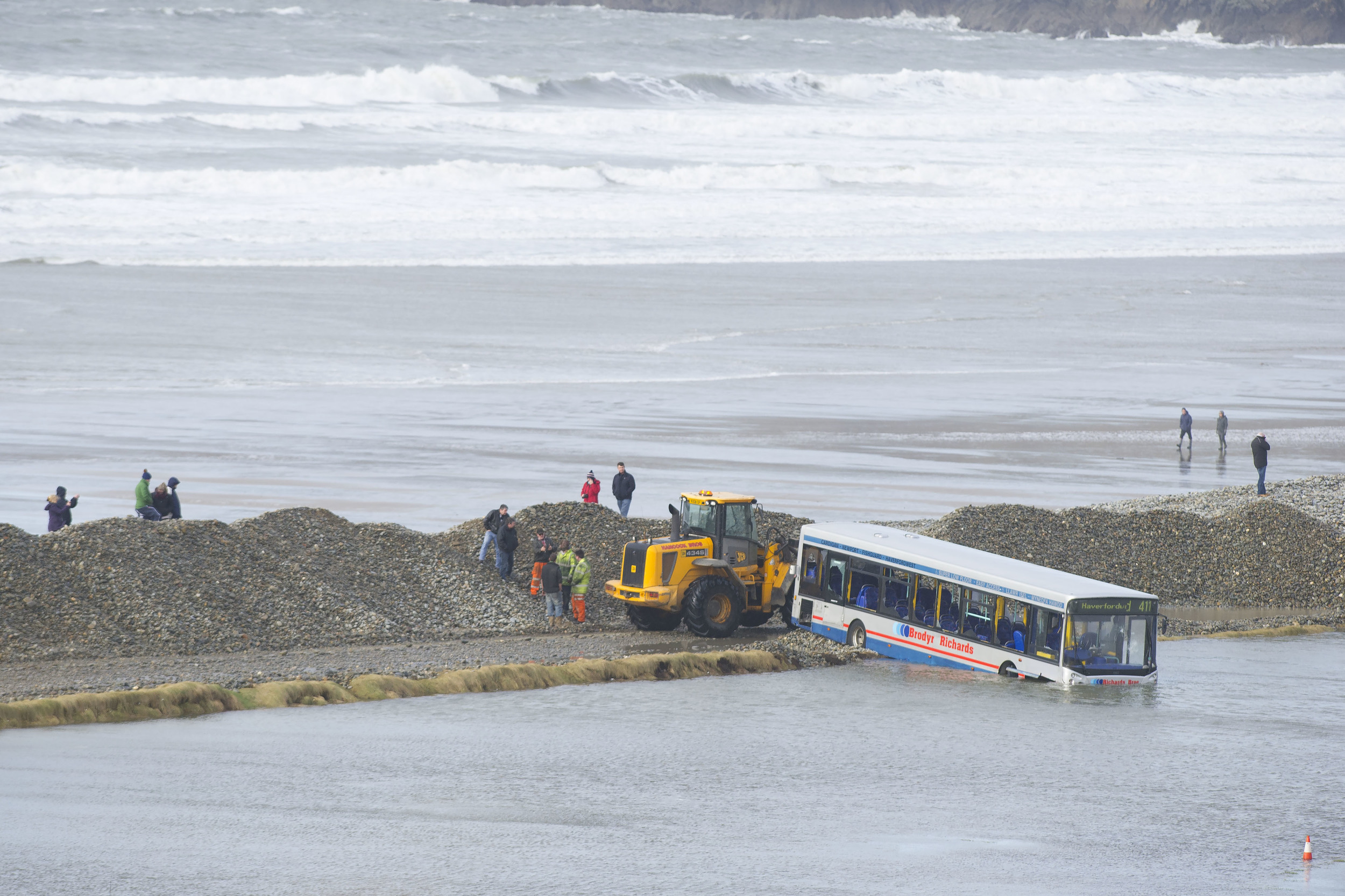 A bus is partially  submerged in water on the A487  in Newgale, West Wales, after heavy rain, severe flooding and strong waves on the night of Saturday February 1.