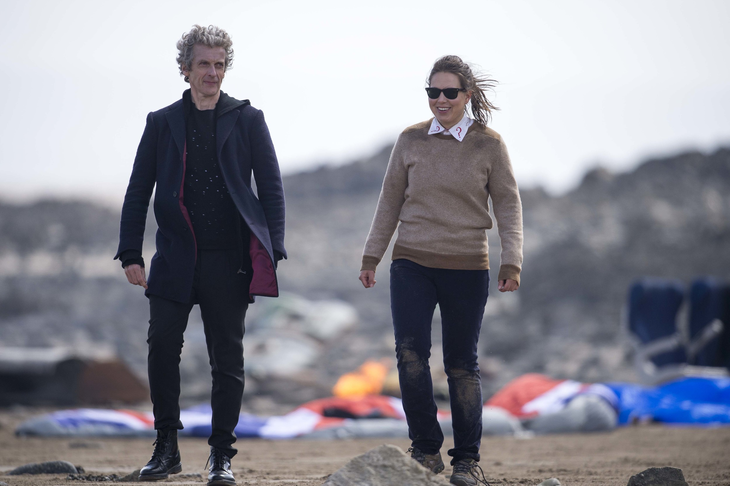 BARRY, WALES - MAY 18: The Doctor Peter Capaldi is spotted with Ingrid Oliver during filming for the ninth series of BBC show Doctor Who at Barry beach on May 18, 2015 in Barry, Wales. An area on the beach had been set up to look as if a plane had crashed. (Photo by Matthew Horwood)