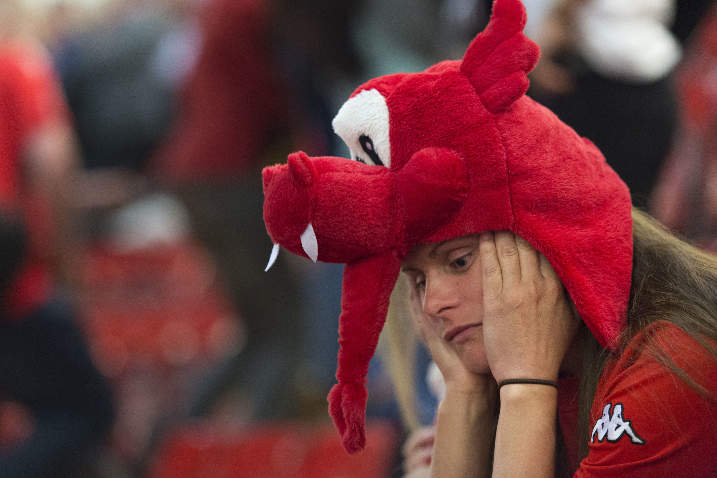 CARDIFF, WALES - JULY 06: A dejected Welsh football fan looks on while watching the Wales v Portugal Euro 2016 semi-final match on a big screen in the Principality Stadium on July 6, 2016 in Cardiff, Wales. Portugal beat Wales 2-0 at Stade de Lyon in France, knocking Wales out of the competition. (Photo by Matthew Horwood)