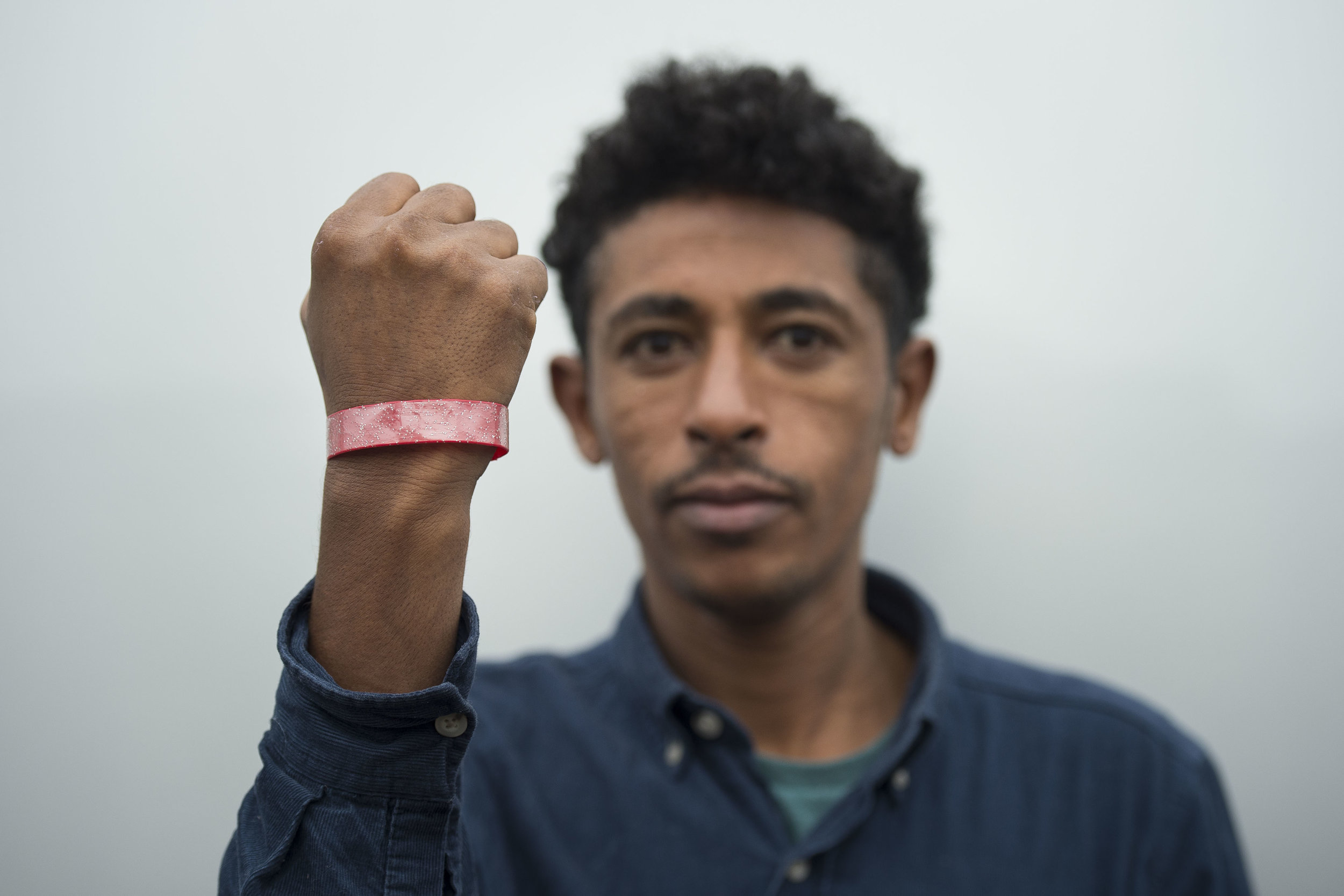 Asylum seekers staying at Lynx House on Newport Road in Cardiff, South Wales, have been given brightly coloured wrist bands to wear in order to claim food.Picture shows Zekaryas Eyob of Eritrea who was made to wear a wrist band.PIC Matthew Horwood© WALES NEWS SERVICE