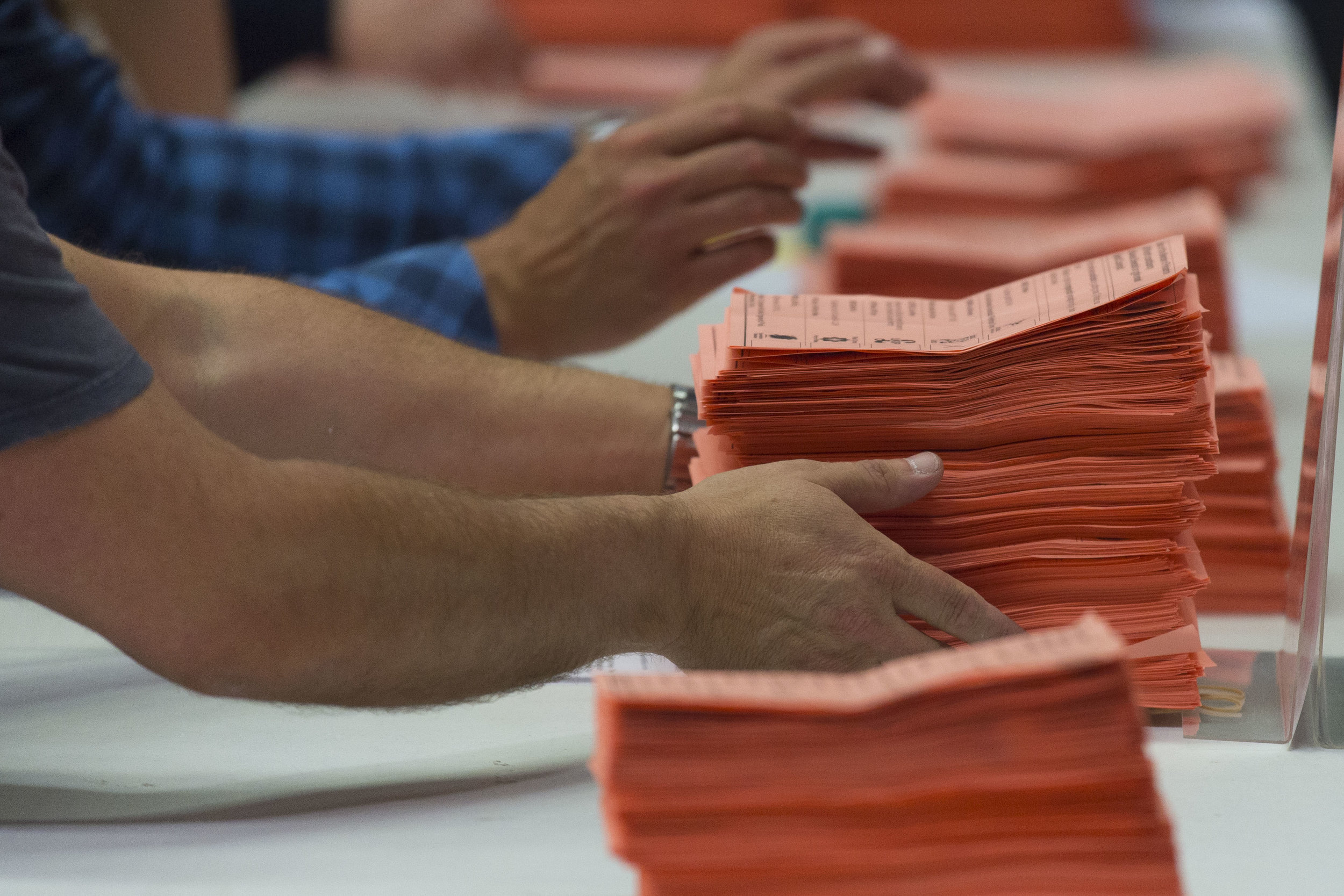 CARDIFF, UNITED KINGDOM - JUNE 09: Ballot papers are counted at the Sport Wales National Centre on June 9, 2017 in Cardiff, United Kingdom. After a snap election was called, the United Kingdom went to the polls yesterday following a closely fought election. The results from across the country are being counted and an overall result is expected in the early hours. (Photo by Matthew Horwood/Getty Images)