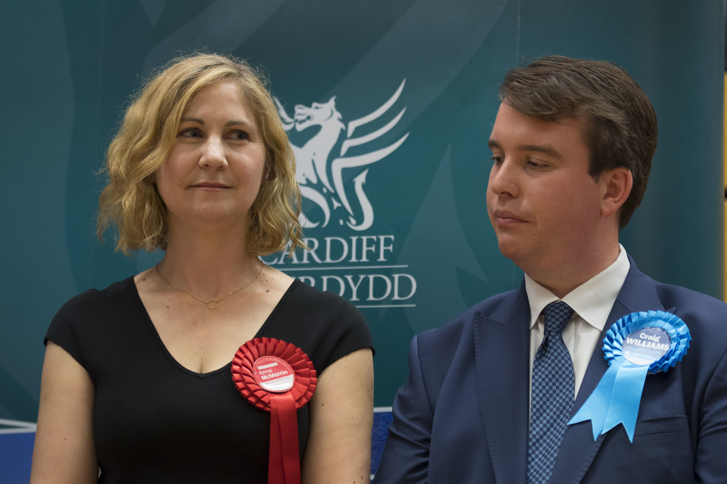 CARDIFF, UNITED KINGDOM - JUNE 09: Anna McMorrin (L) stands on stage with former Cardiff North MP Craig Williams (R) after winning Cardiff North for Labour at the Sport Wales National Centre on June 9, 2017 in Cardiff, United Kingdom. After a snap election was called, the United Kingdom went to the polls yesterday following a closely fought election. The results from across the country are being counted and an overall result is expected in the early hours. (Photo by Matthew Horwood/Getty Images)