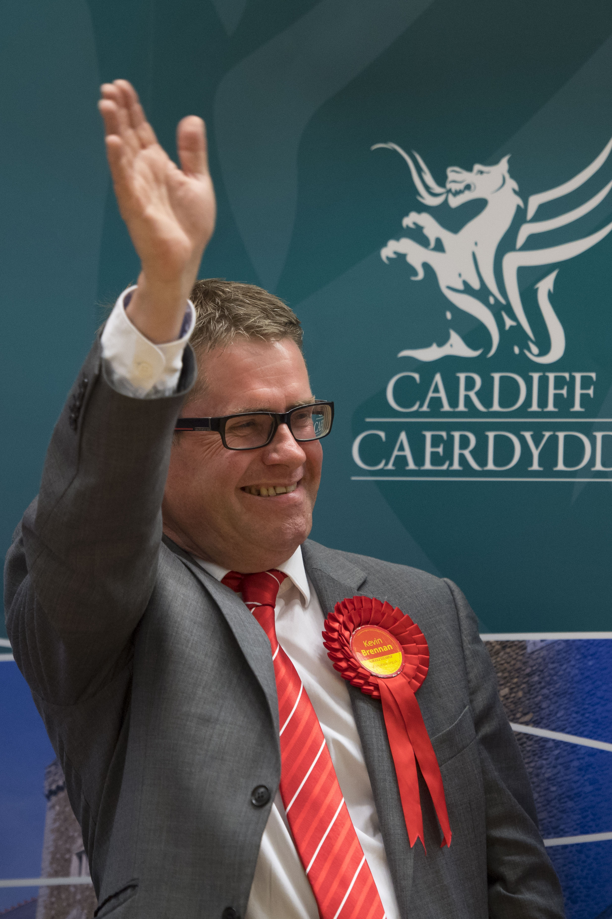 CARDIFF, UNITED KINGDOM - JUNE 09: Kevin Brennan waves to supporters after winning Cardiff West for Labour at the Sport Wales National Centre on June 9, 2017 in Cardiff, United Kingdom. After a snap election was called, the United Kingdom went to the polls yesterday following a closely fought election. The results from across the country are being counted and an overall result is expected in the early hours. (Photo by Matthew Horwood/Getty Images)