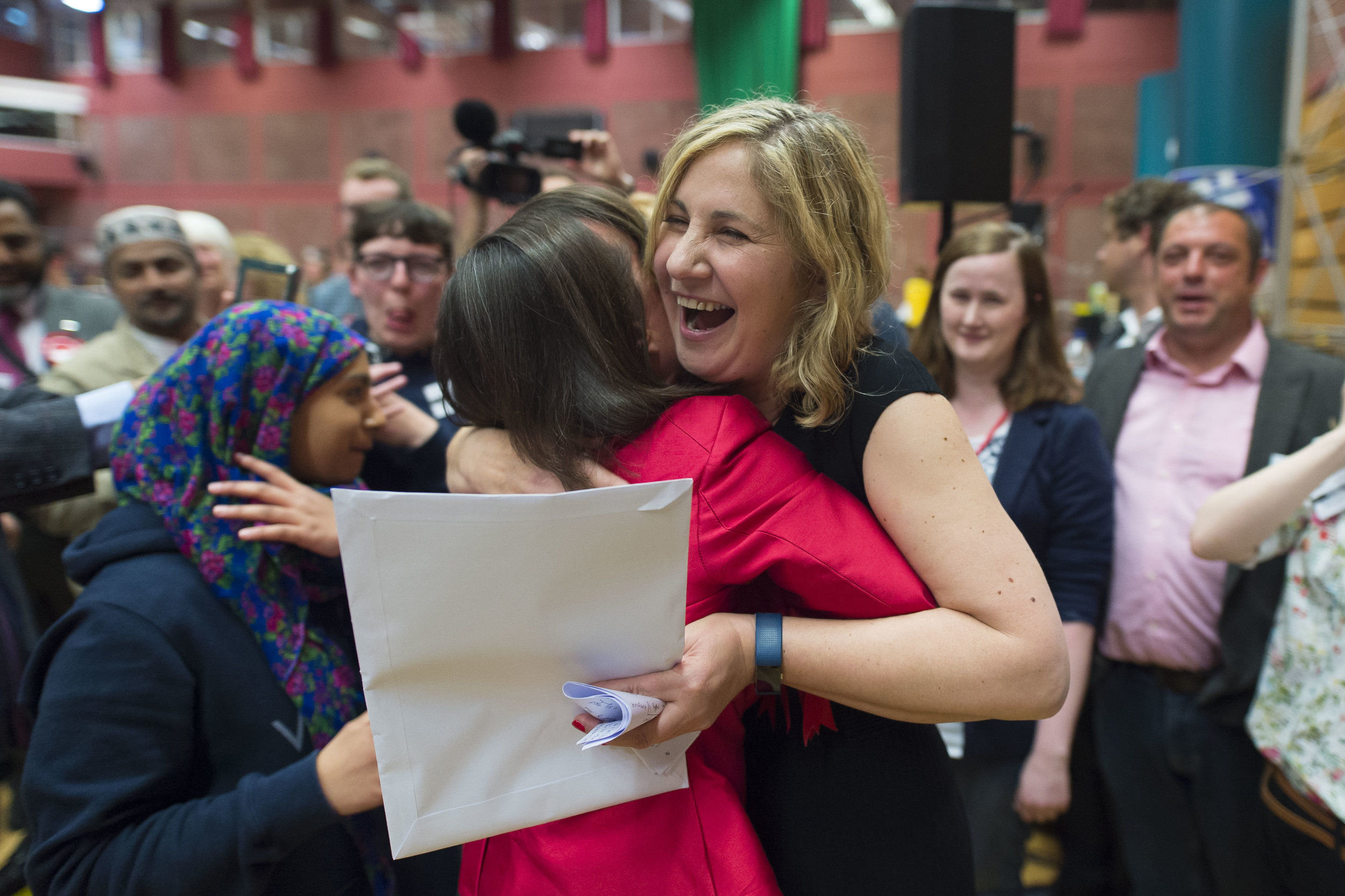 CARDIFF, UNITED KINGDOM - JUNE 09: Anna McMorrin hugs Jo Stevens MP after winning Cardiff North for Labour at the Sport Wales National Centre on June 9, 2017 in Cardiff, United Kingdom. After a snap election was called, the United Kingdom went to the polls yesterday following a closely fought election. The results from across the country are being counted and an overall result is expected in the early hours. (Photo by Matthew Horwood/Getty Images)