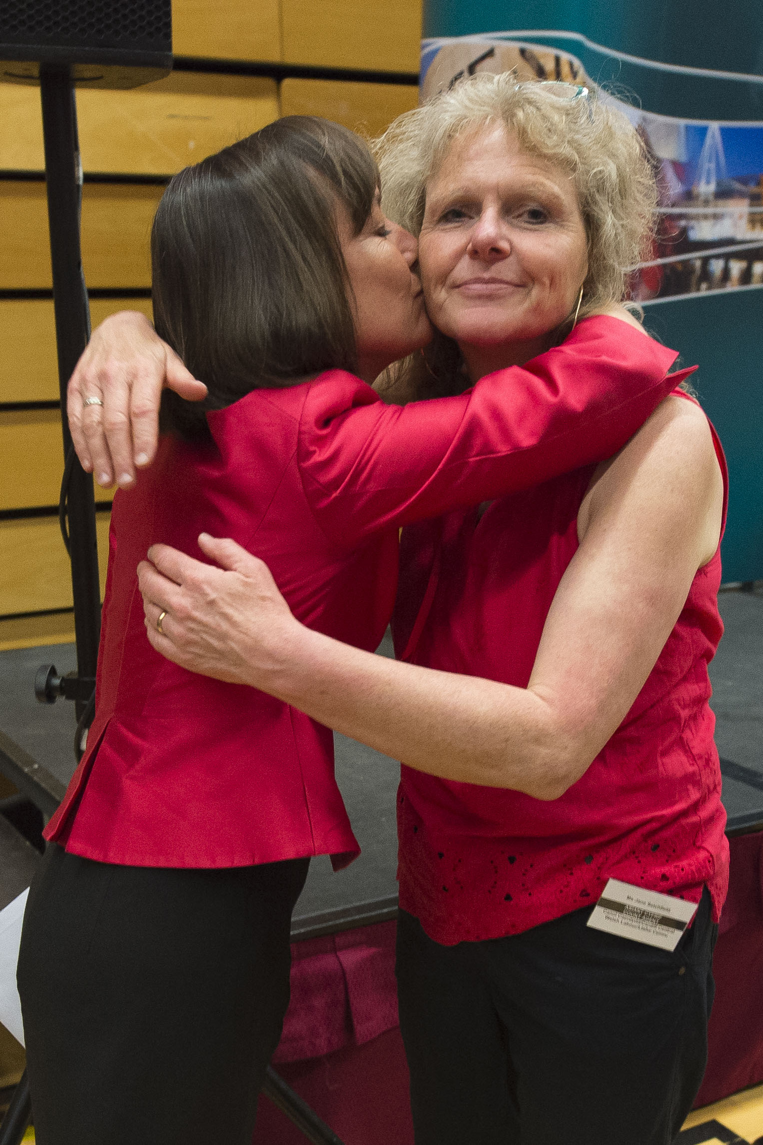 CARDIFF, UNITED KINGDOM - JUNE 09: Jo Stevens (L) kisses a party member after winning Cardiff Central for Labour, increasing her majority to more than 17,000, at the Sport Wales National Centre on June 9, 2017 in Cardiff, United Kingdom. After a snap election was called, the United Kingdom went to the polls yesterday following a closely fought election. The results from across the country are being counted and an overall result is expected in the early hours. (Photo by Matthew Horwood/Getty Images)